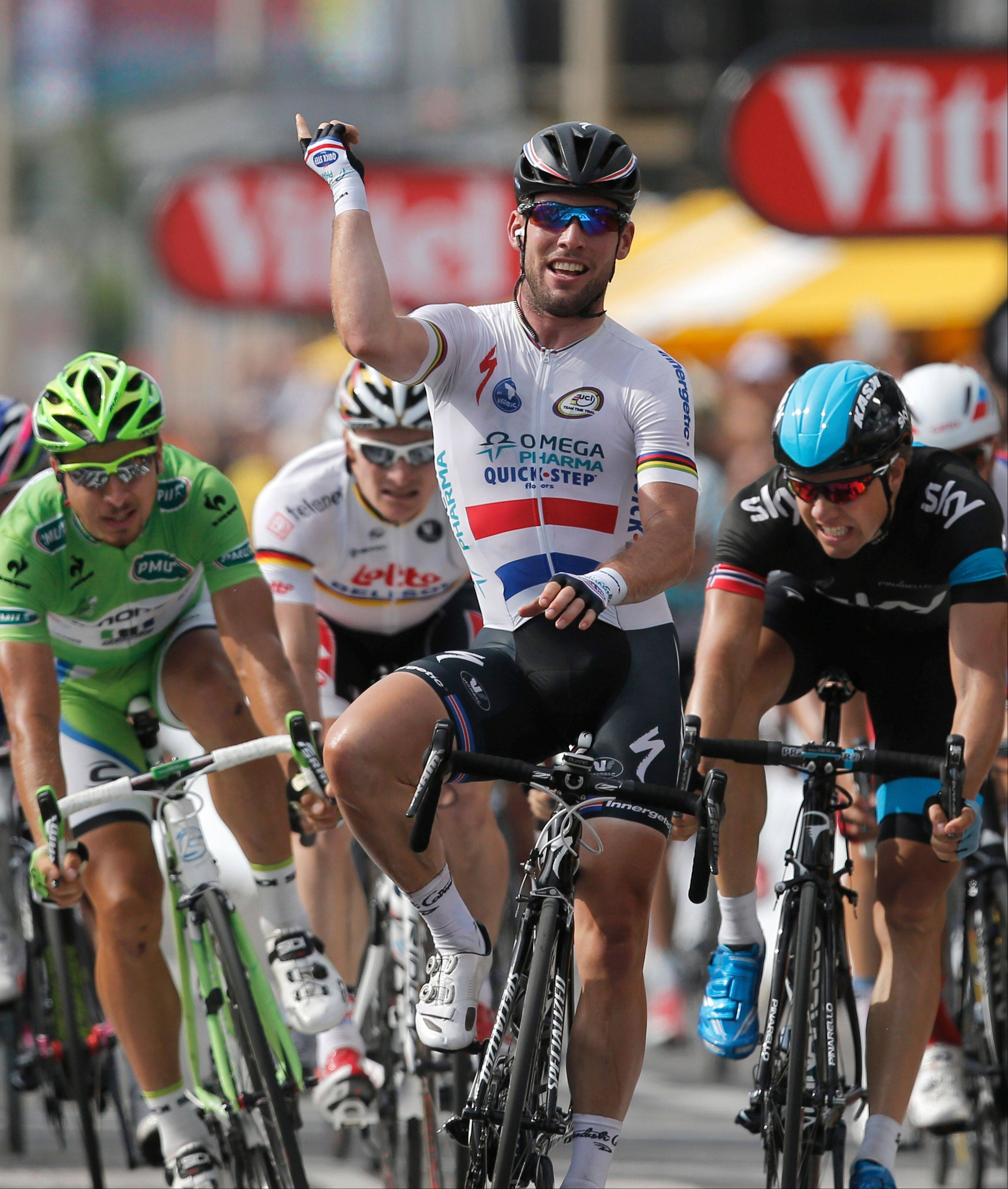 Britain's Marc Cavendish crosses the finish line ahead of Edvald Boasson Hagen of Norway, Peter Sagan of Slovakia and Andre Greipel of Germany to win the fifth stage of the Tour de France on Wednesday in Marseille.