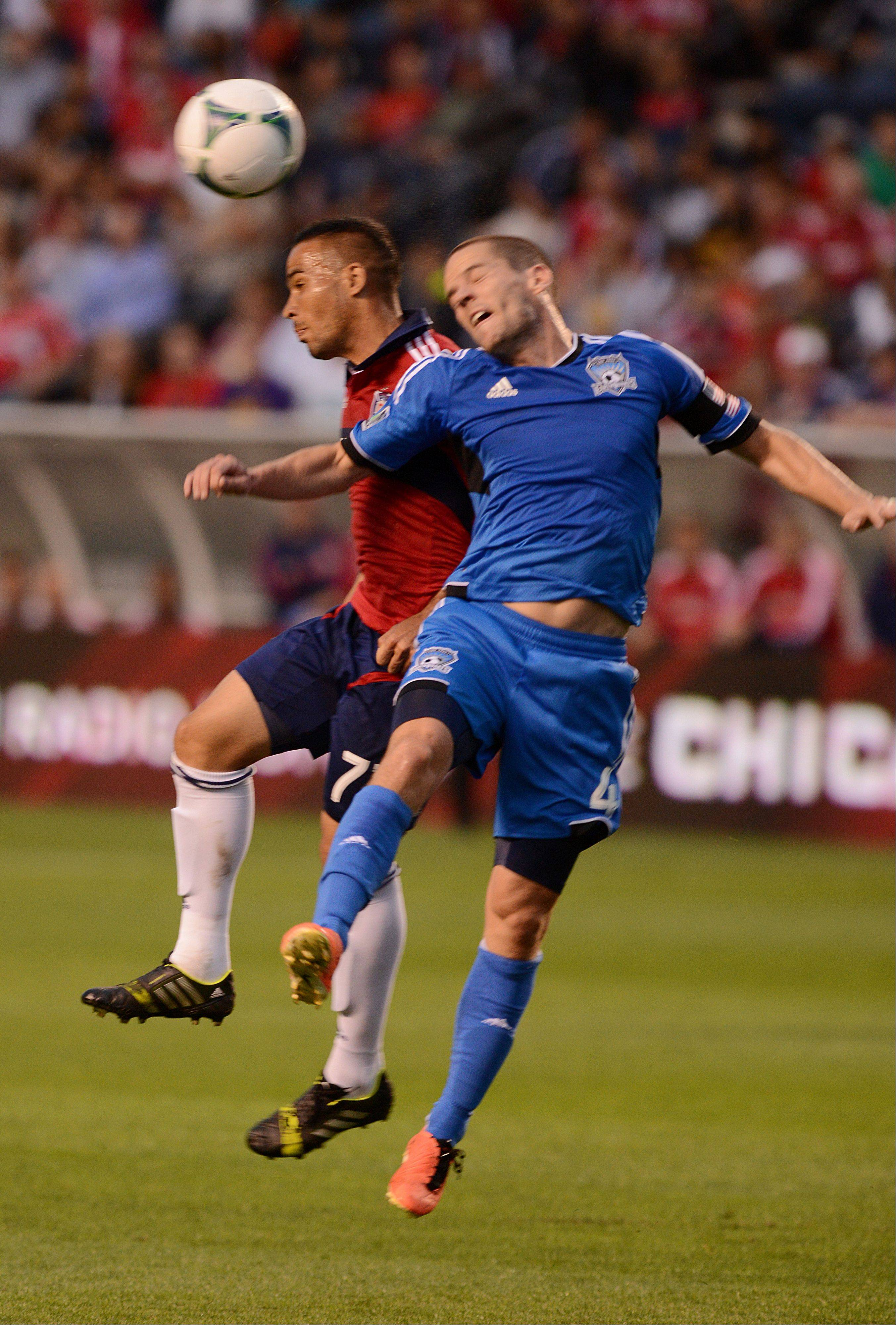 Alex of the Chicago Fire and Sam Cronin of San Jose Earthquakes battle for control of the ball Wednesday night during a game in Bridgeview.