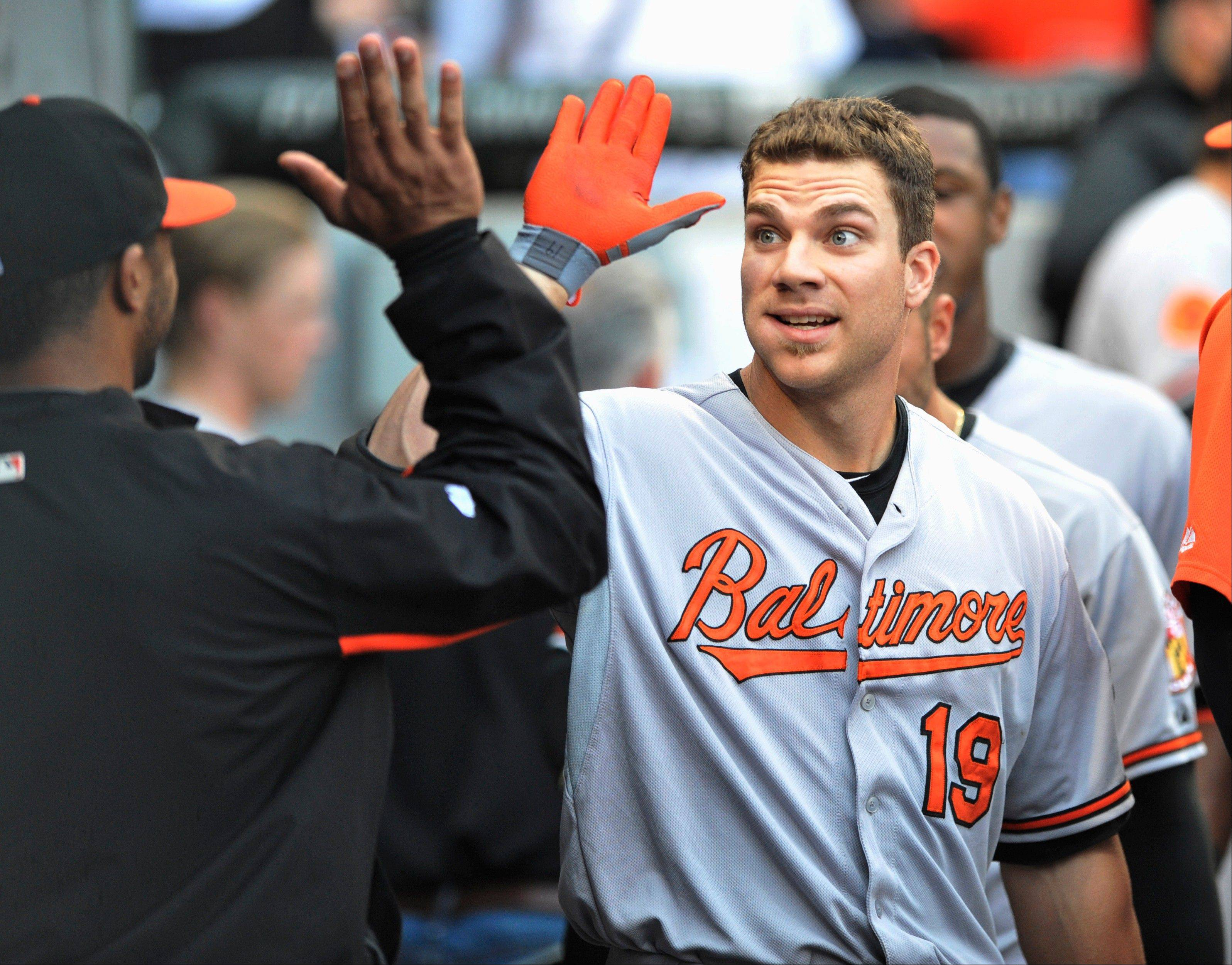 Baltimore's Chris Davis (19) celebrates with teammates in the dugout after hitting a solo home run during the fourth inning on Wednesday night against the Sox.