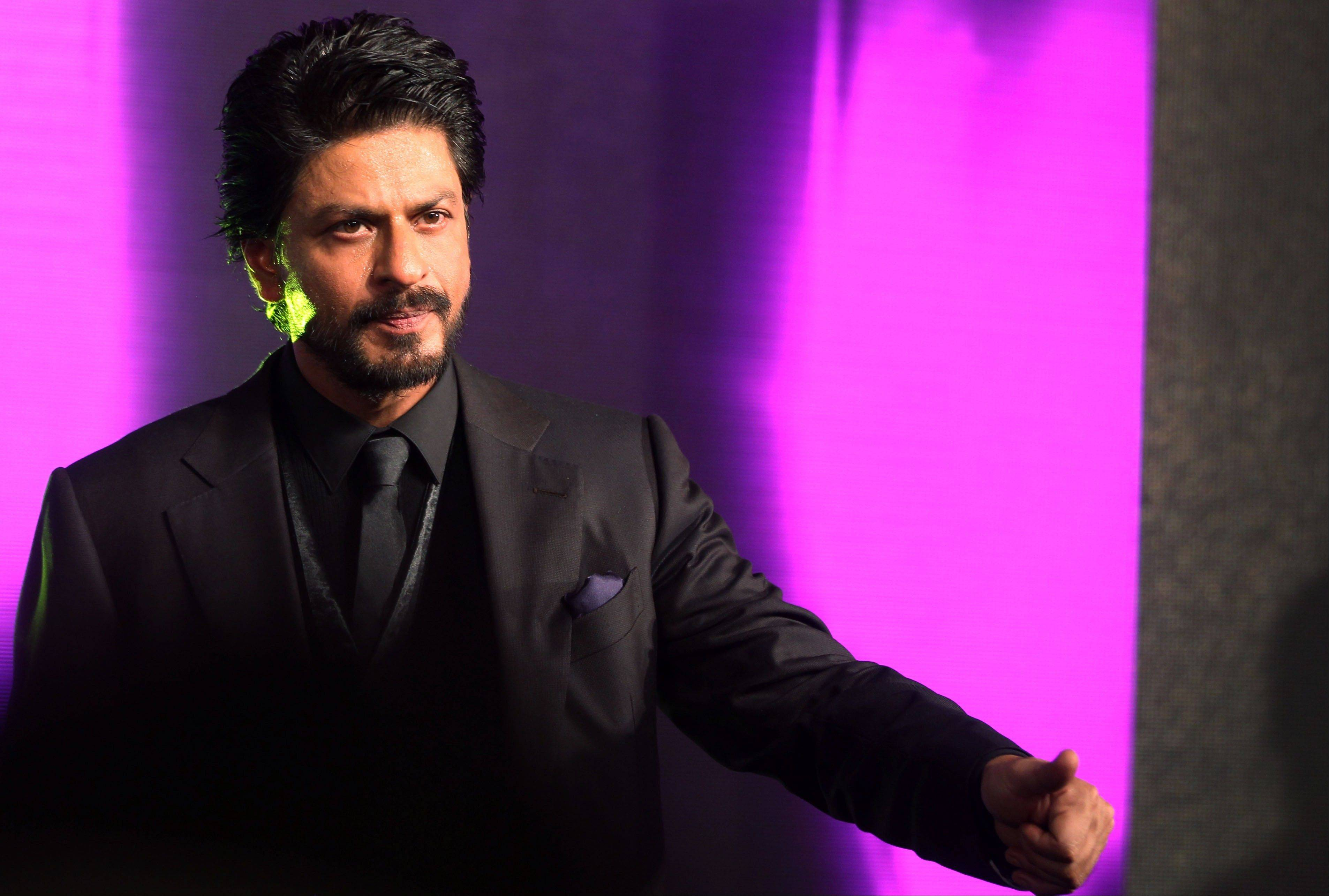 In this Wednesday, July 3, 2013 photo, Bollywood actor Shah Rukh Khan speaks during the releasing of the music of his upcoming movie �Chennai Express� in Mumbai, India. Shah Rukh Khan confirmed late Wednesday that he�s the father of a new baby amid feverish media speculation.