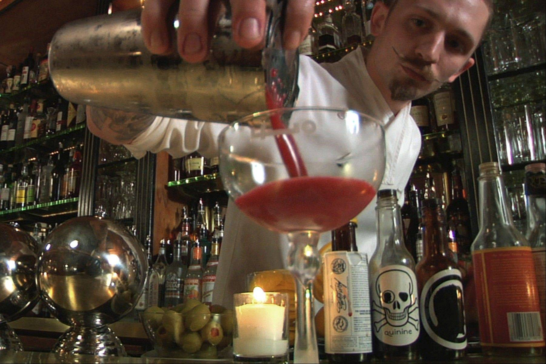 "Steve Schneider, a former U.S. Marine, reinvented himself as a drink-mixing rock star in the documentary ""Hey Bartender."""