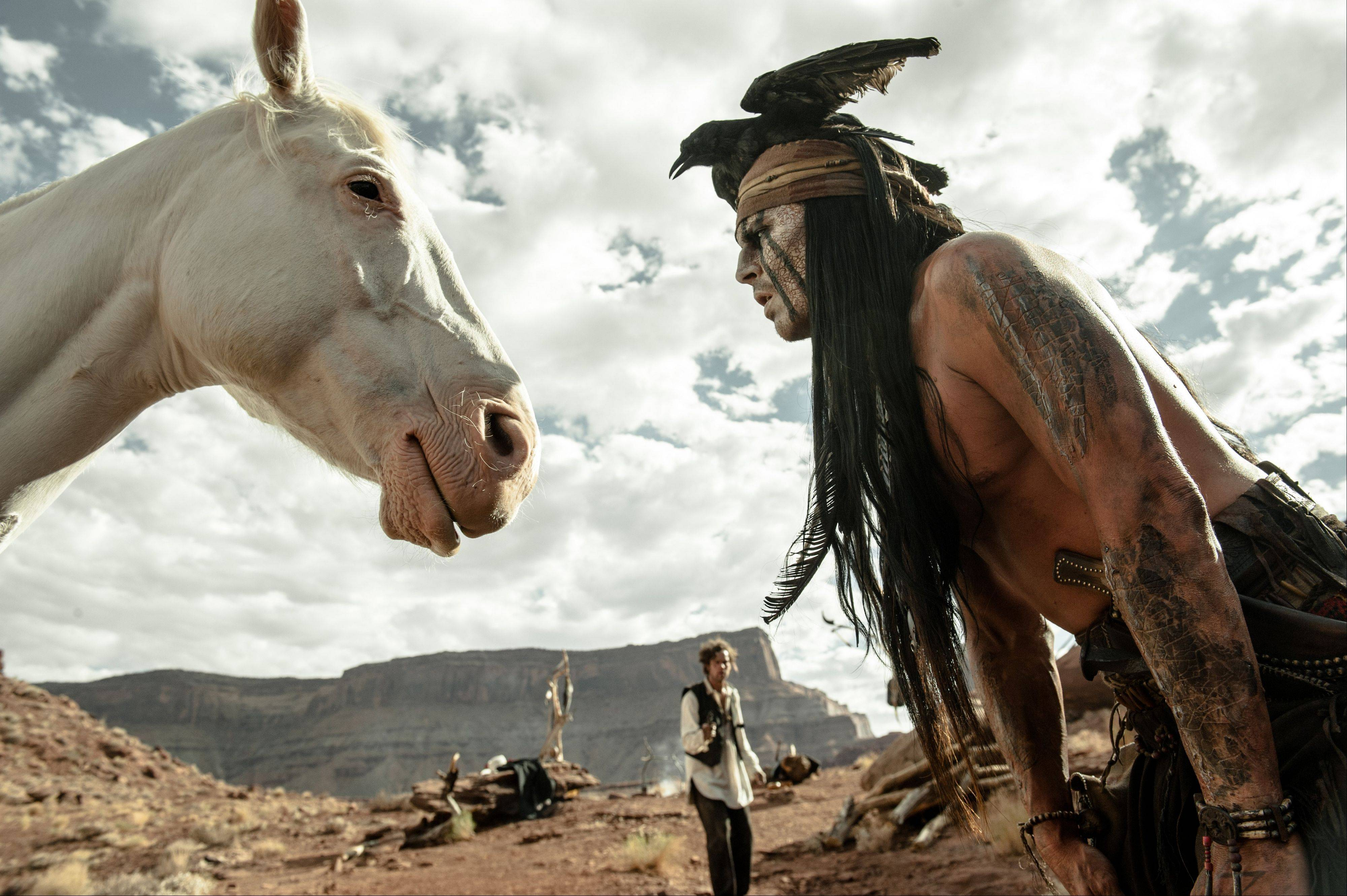 "This publicity image released by Disney shows Johnny Depp as Tonto, right, and Armie Hammer as The Lone Ranger, in a scene from ""The Lone Ranger."""