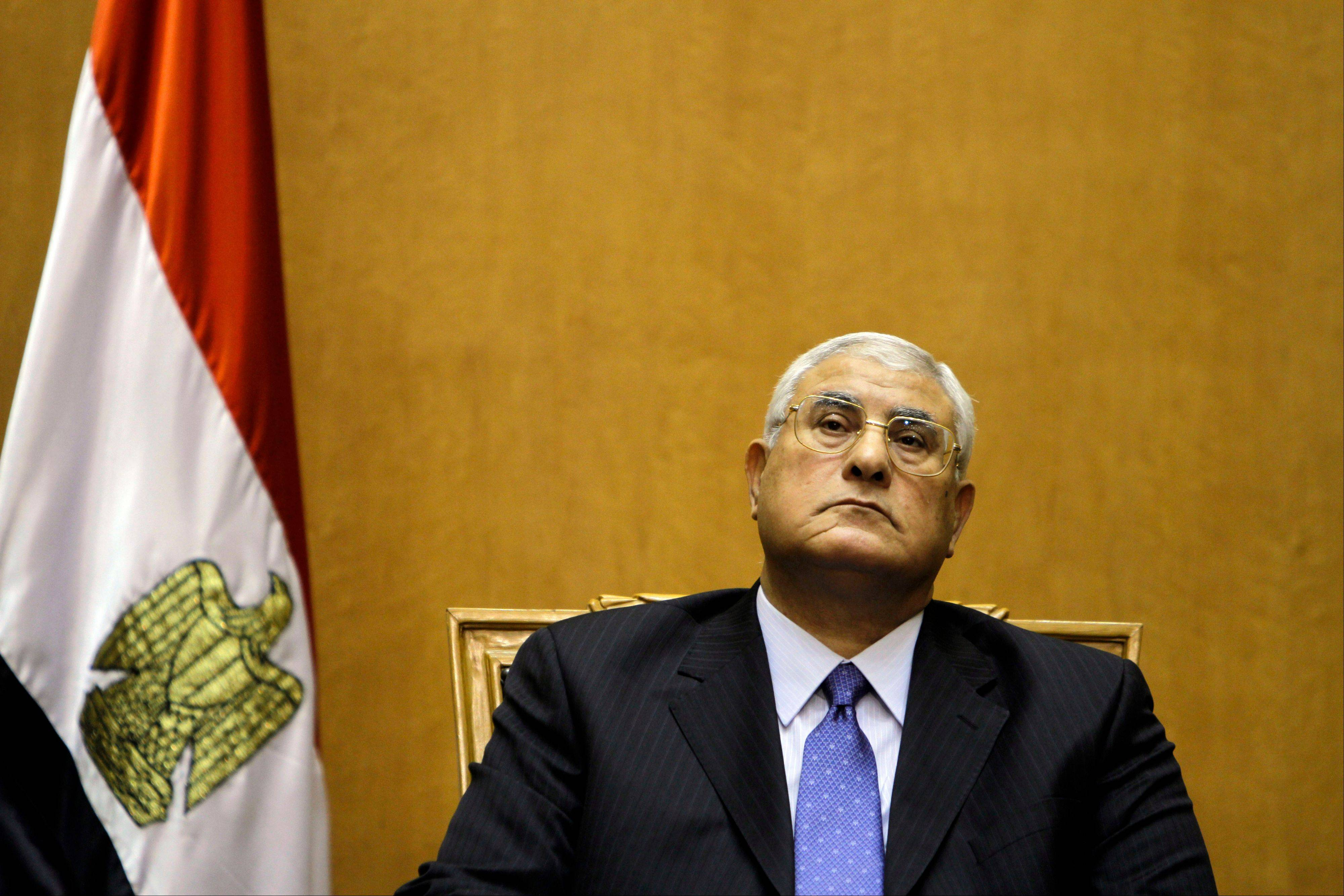 Egypt's chief justice Adly Mansour prepares to be sworn in as the nation's interim president Thursday, July 4, 2013. The chief justice of Egypt's Supreme Constitutional Court was sworn in Thursday as the nation's interim president, taking over hours after the military ousted the Islamist President Mohammed Morsi.