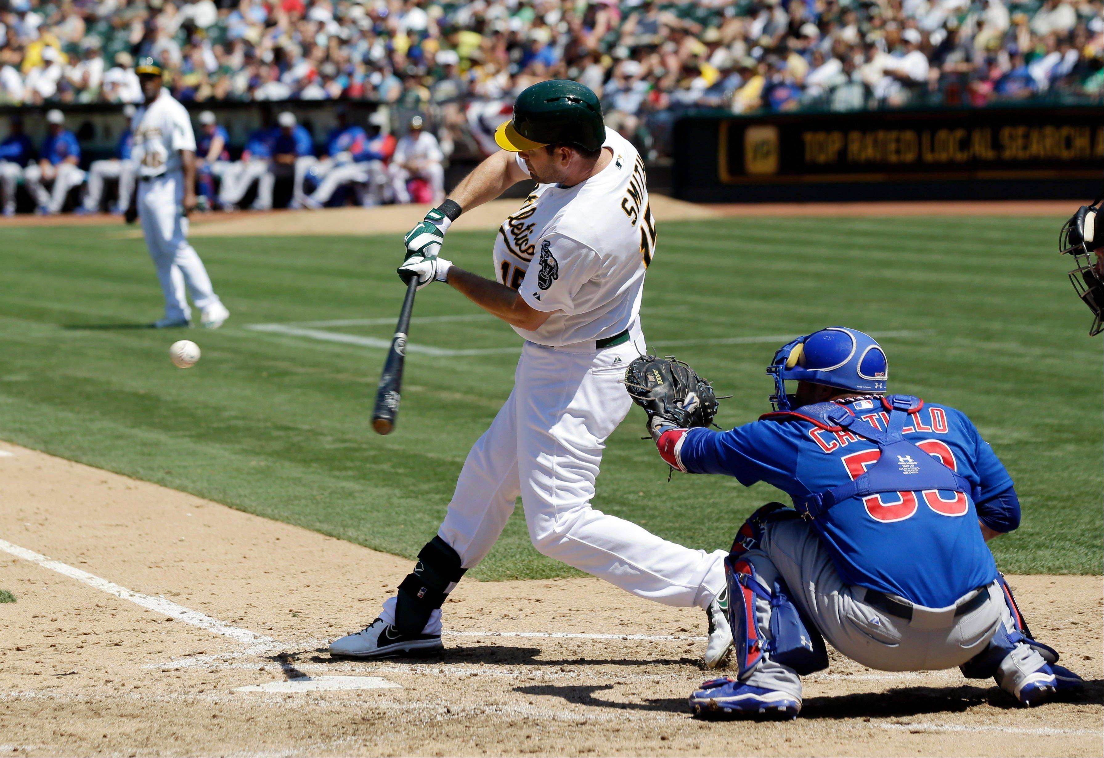 Oakland Athletics' Seth Smith singles against the Cubs during the seventh inning of a baseball game Thursday, July 4, 2013 in Oakland, Calif.