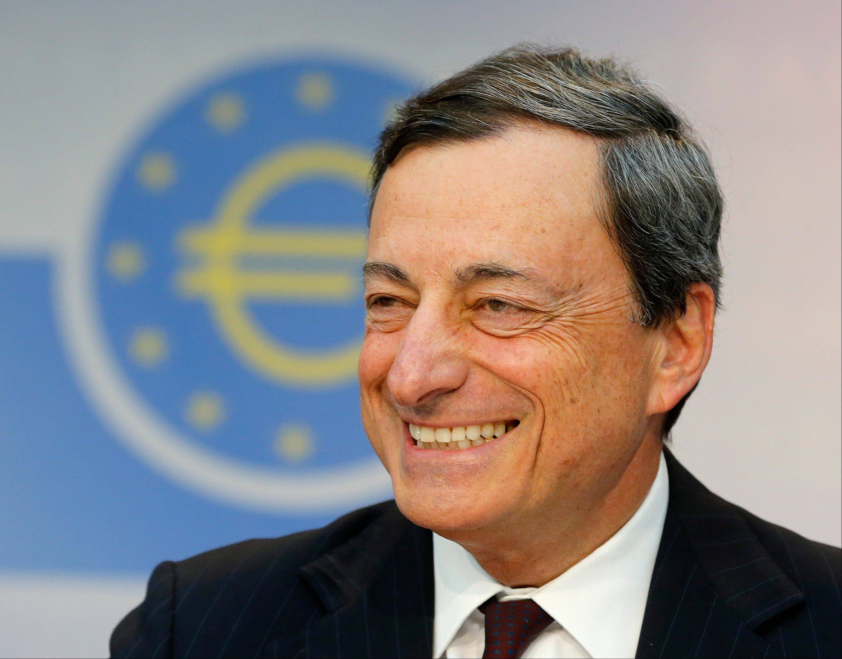 President of European Central Bank Mario Draghi smiles during a news conference in Frankfurt, Germany, Thursday, following a meeting of the ECB governing council. The ECB decided to leave the key interest rate unchanged.