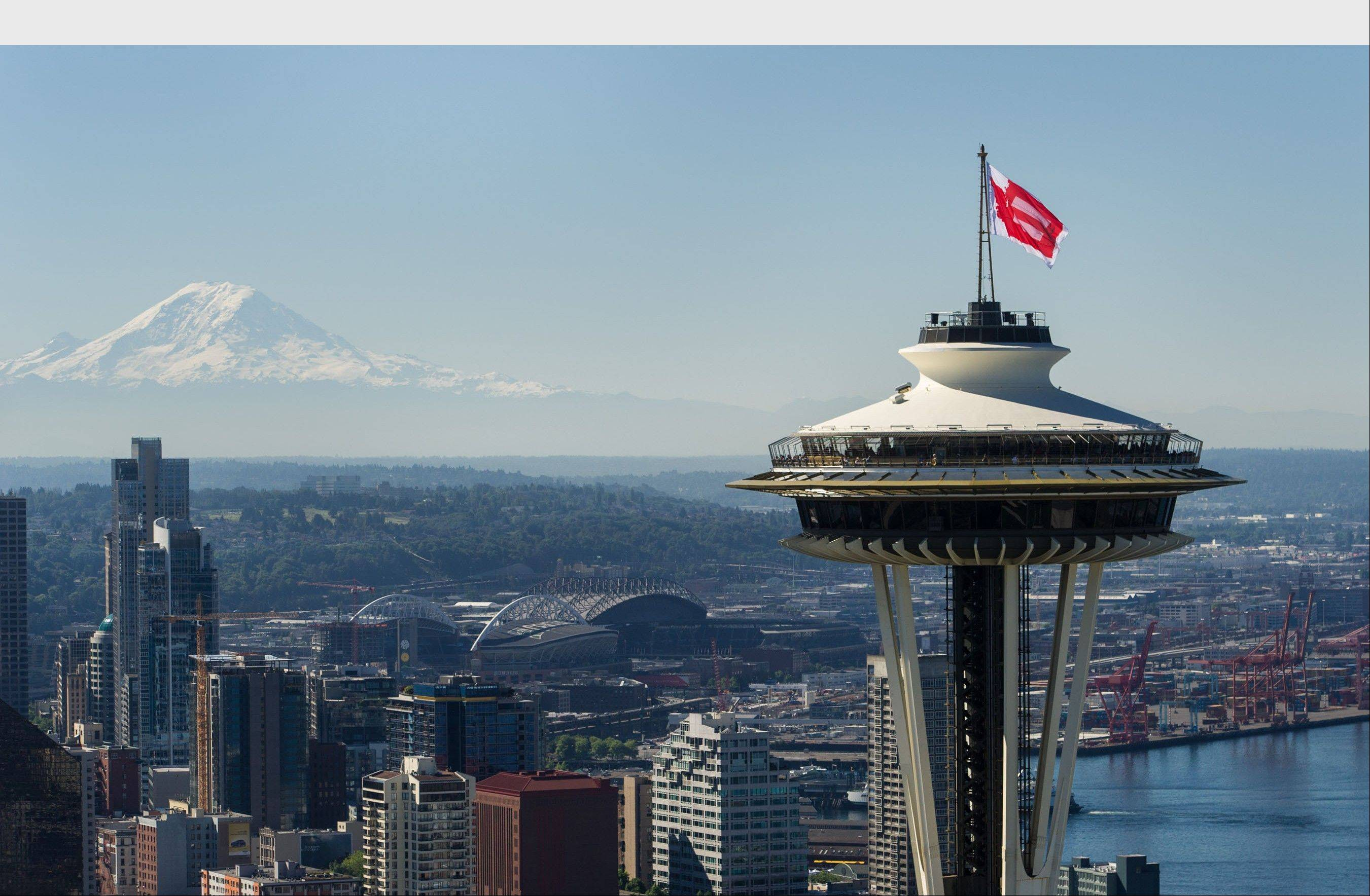 The Space Needle flies Marriage Equality flag atop the iconic landmark to celebrate Marriage Equality, Pride, Seattle and Washington State's role in bringing about monumental change for human and civil rights. (PRNewsFoto/Space Needle)