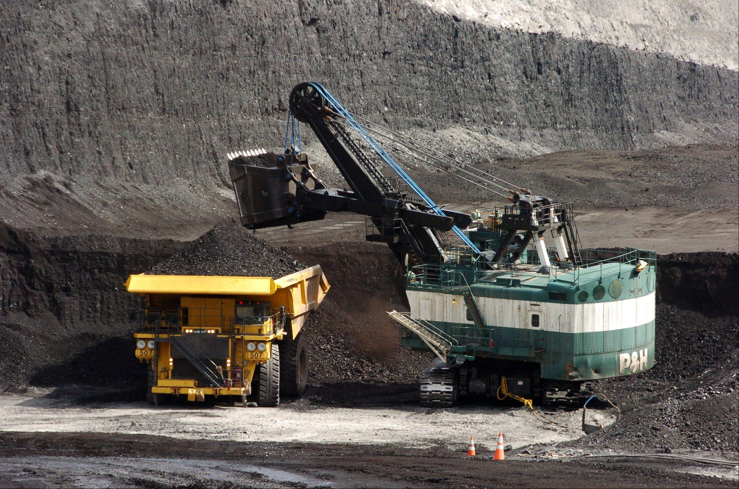 A mechanized shovel loads coal onto a haul truck at the Cloud Peak Energy's Spring Creek mine near Decker, Mont. The coal industry, which was hoping for a rebound in 2013 after struggling to stay competitive in recent years, is back on the defensive after President Barack Obama renewed calls for carbon dioxide reductions from new and existing power plants.