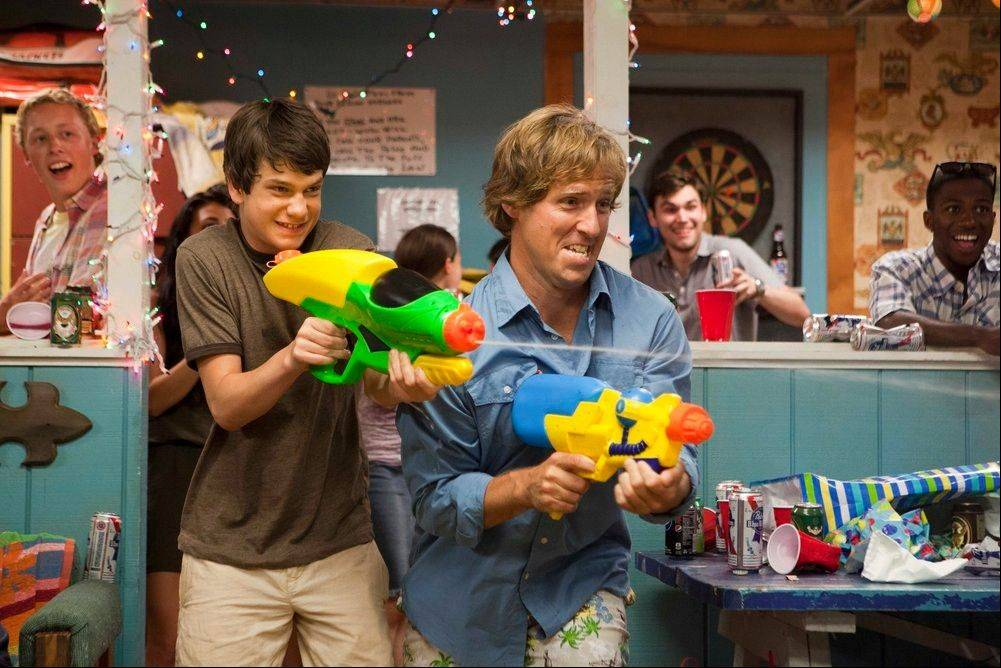 "Duncan (Liam James), left, joins a fellow water park employee (director/writer Nat Faxon) in a scene from ""The Way, Way Back."""
