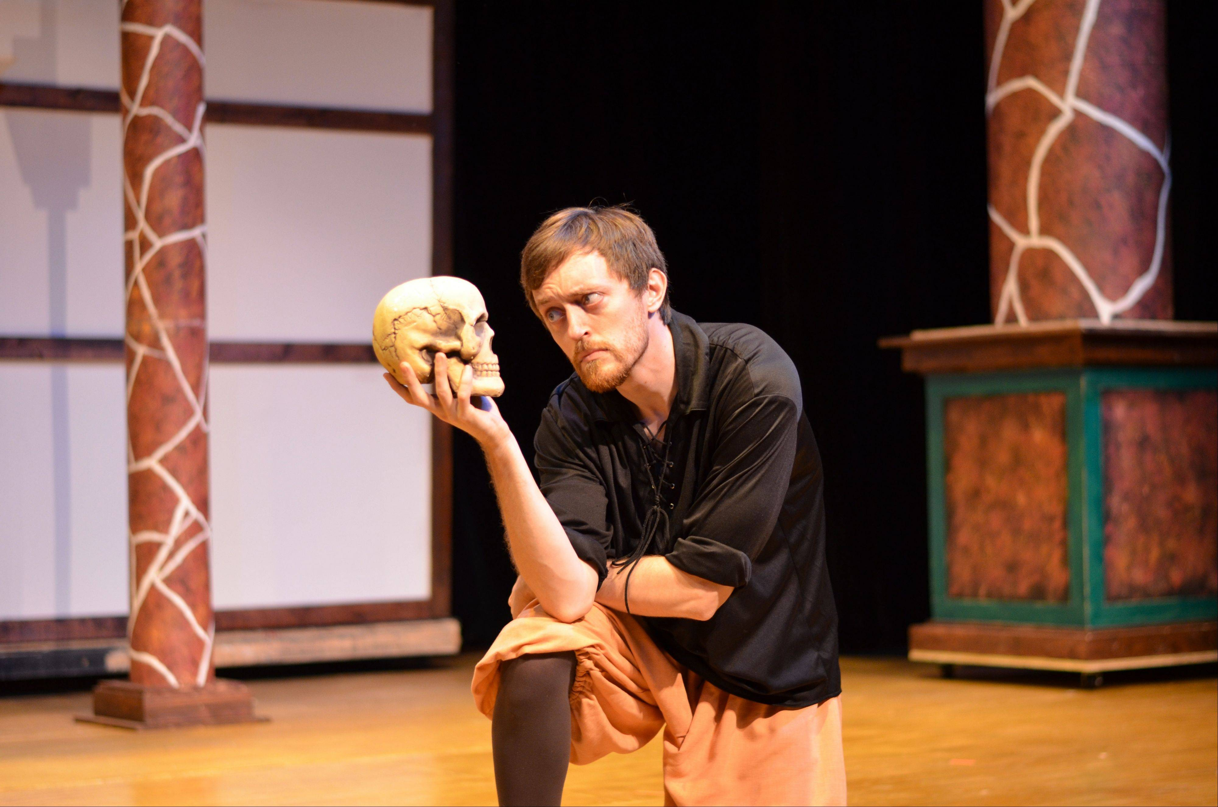 "Michael Woods plays Hamlet contemplating the long-dead Yorick in Eclectic Full Contact Theatre's production of ""The Complete Works of William Shakespeare (Abridged)"" at the Metropolis Performing Arts Centre in Arlington Heights."