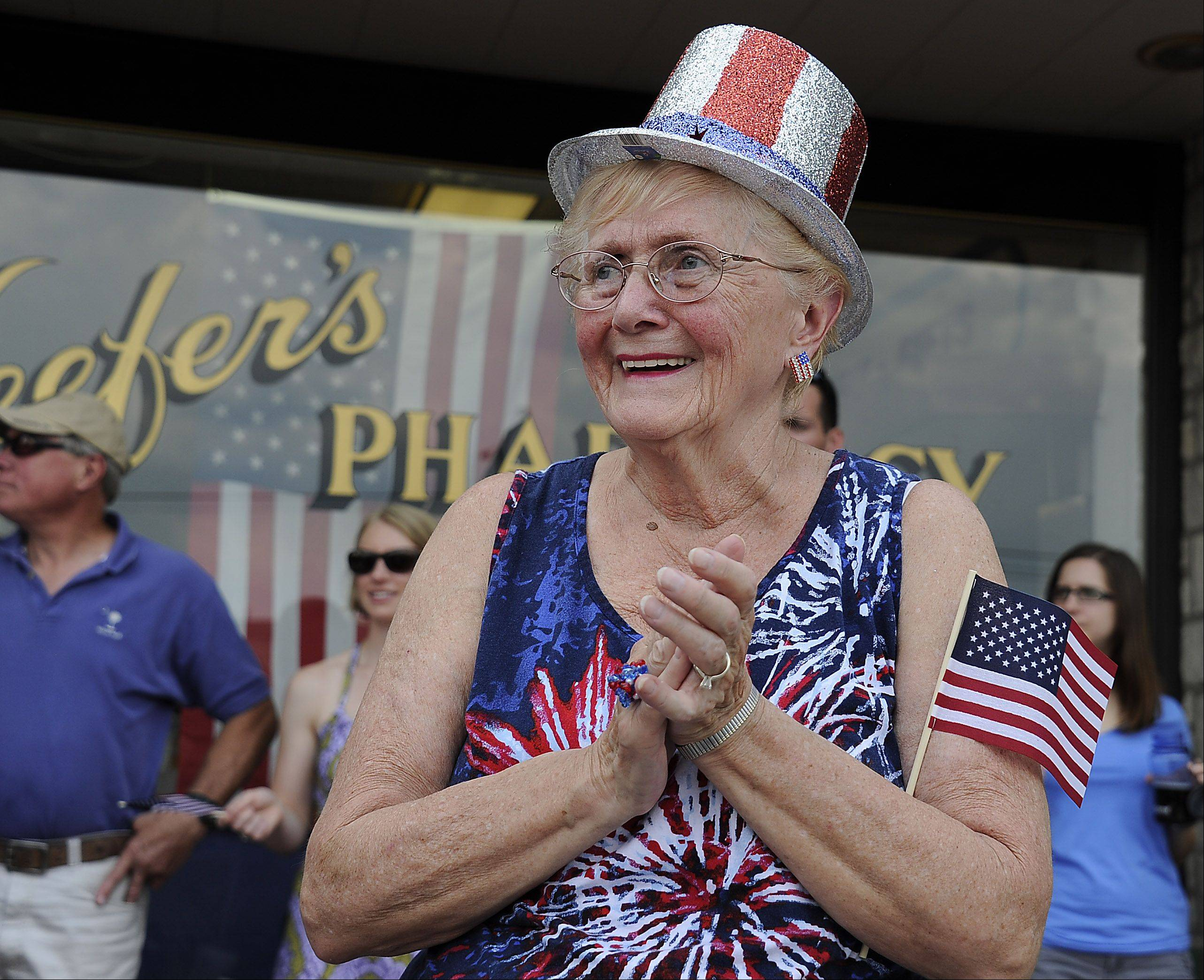Mt. Prospect July Fourth festivities has Doris Kyllingstad of Park Ridge cheering on the military as they march in the parade.