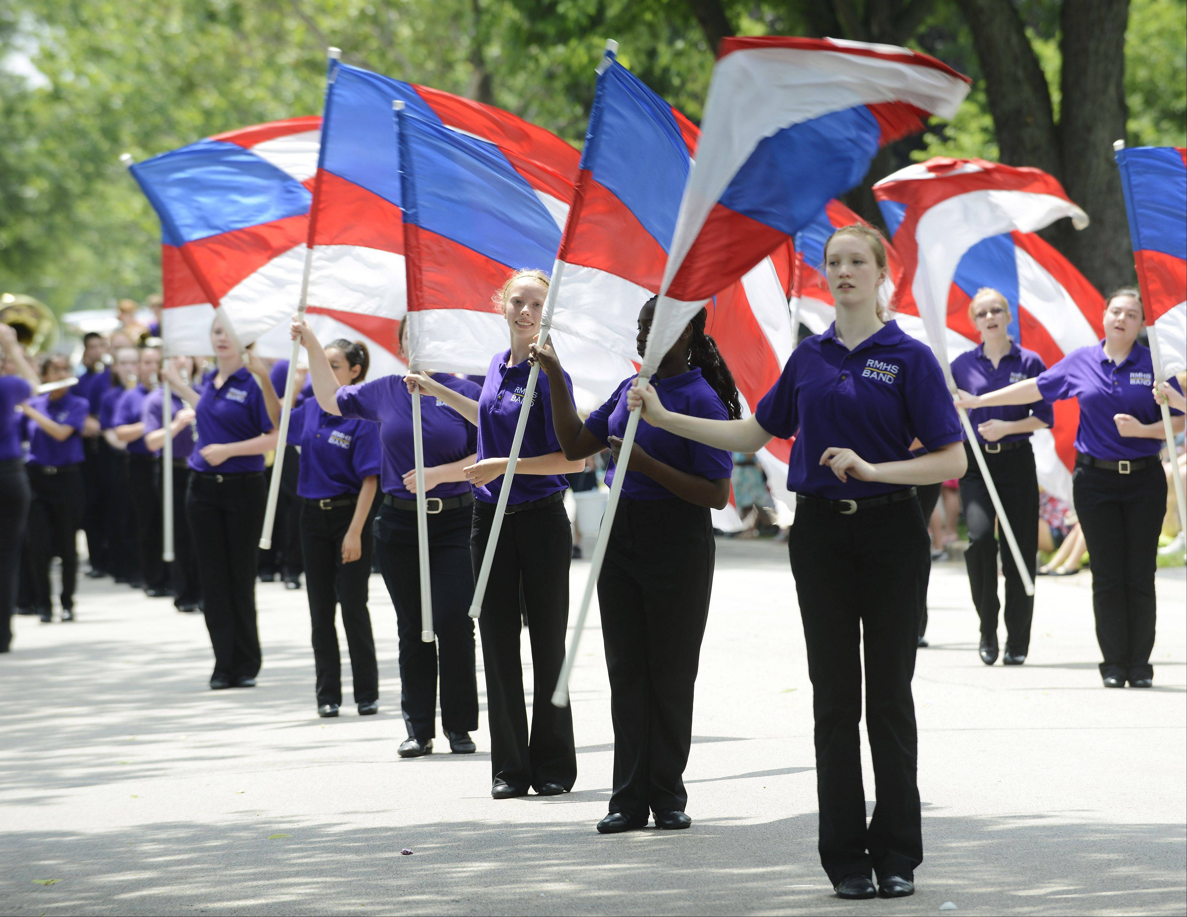 Junior Danielle Sioui, front, is among the members of the Rolling Meadows High School flag team performing during the Rolling Meadows Fourth of July parade Thursday.