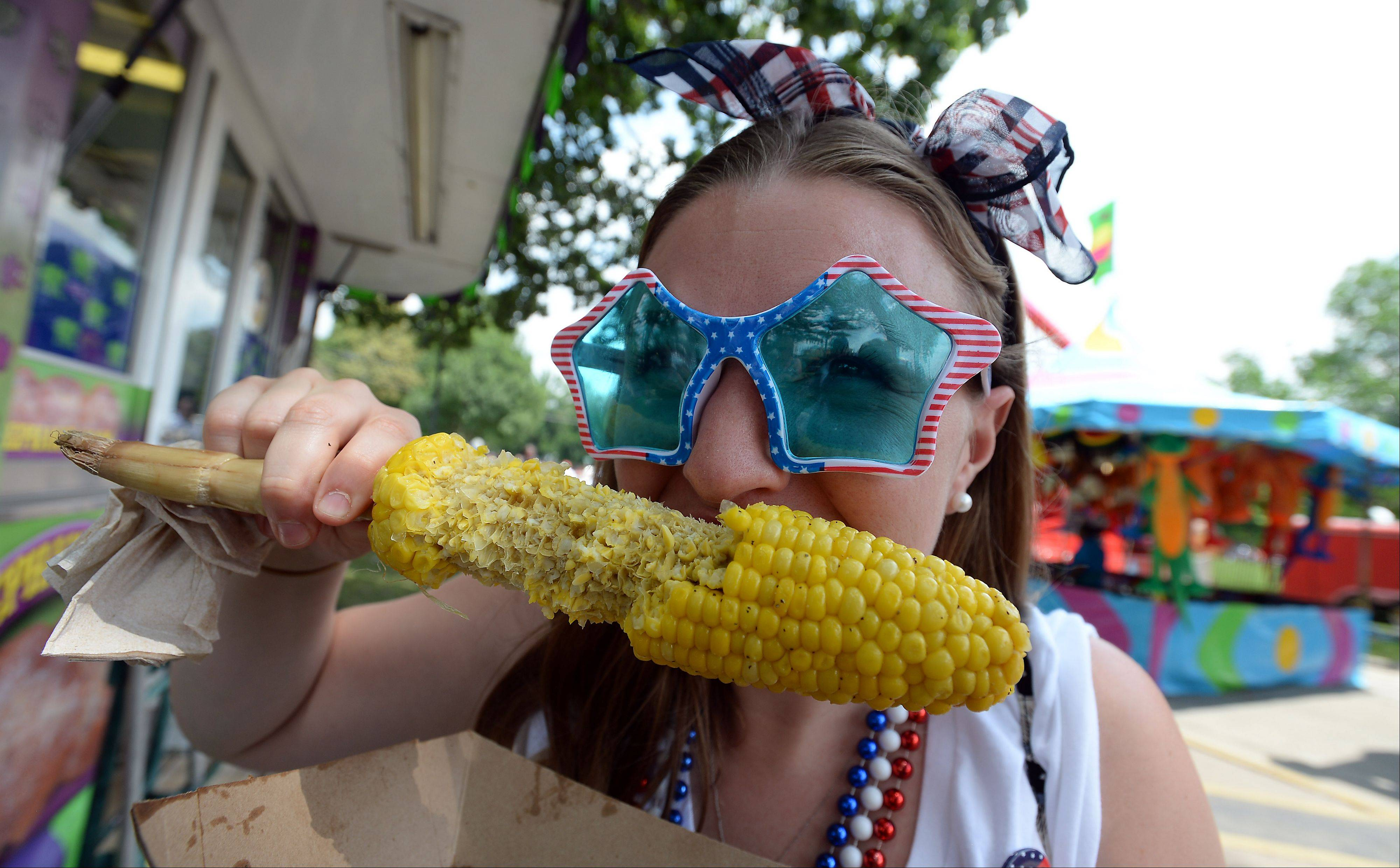 Frontier Days festivities kicks off on the Fourth of July for Lauren Schenkel, 23, of Arlington Heights seeing stars while she polished off a buttery ear of corn.