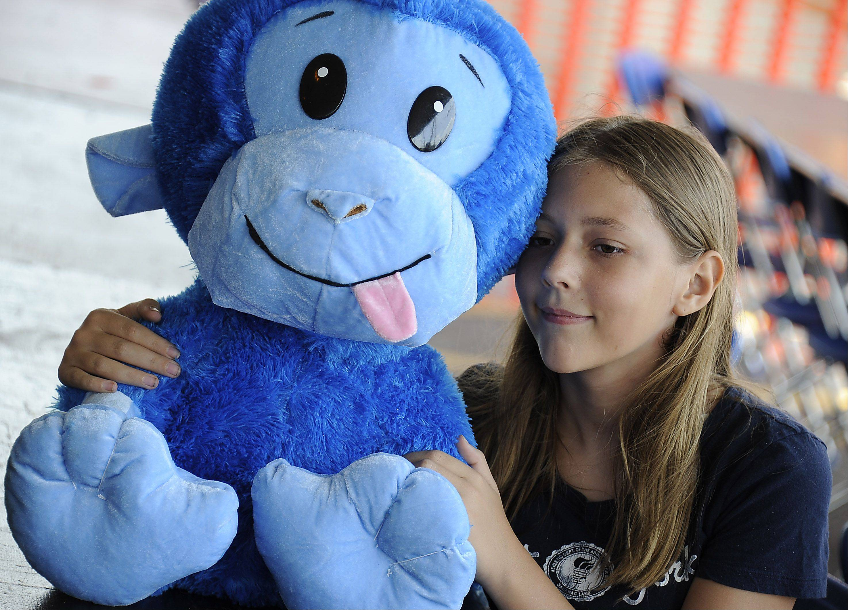 Frontier Days festivities kicks off on the Fourth of July great for Amanda Olsen, 13, of Arlington Heights who won her stuffed monkey at a basketball game.