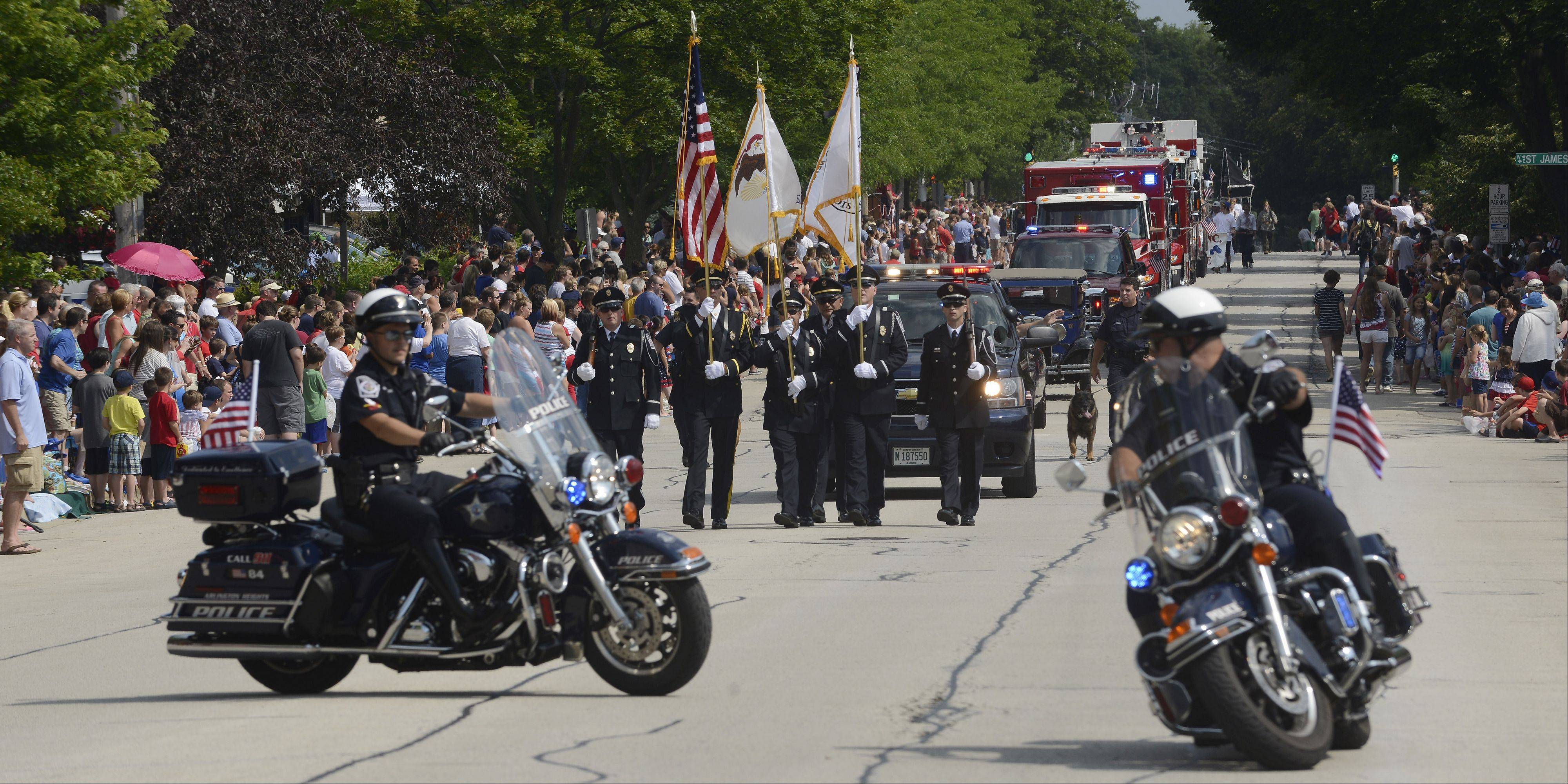 The police department leads the procession during the Arlington Heights Fourth of July parade Thursday.