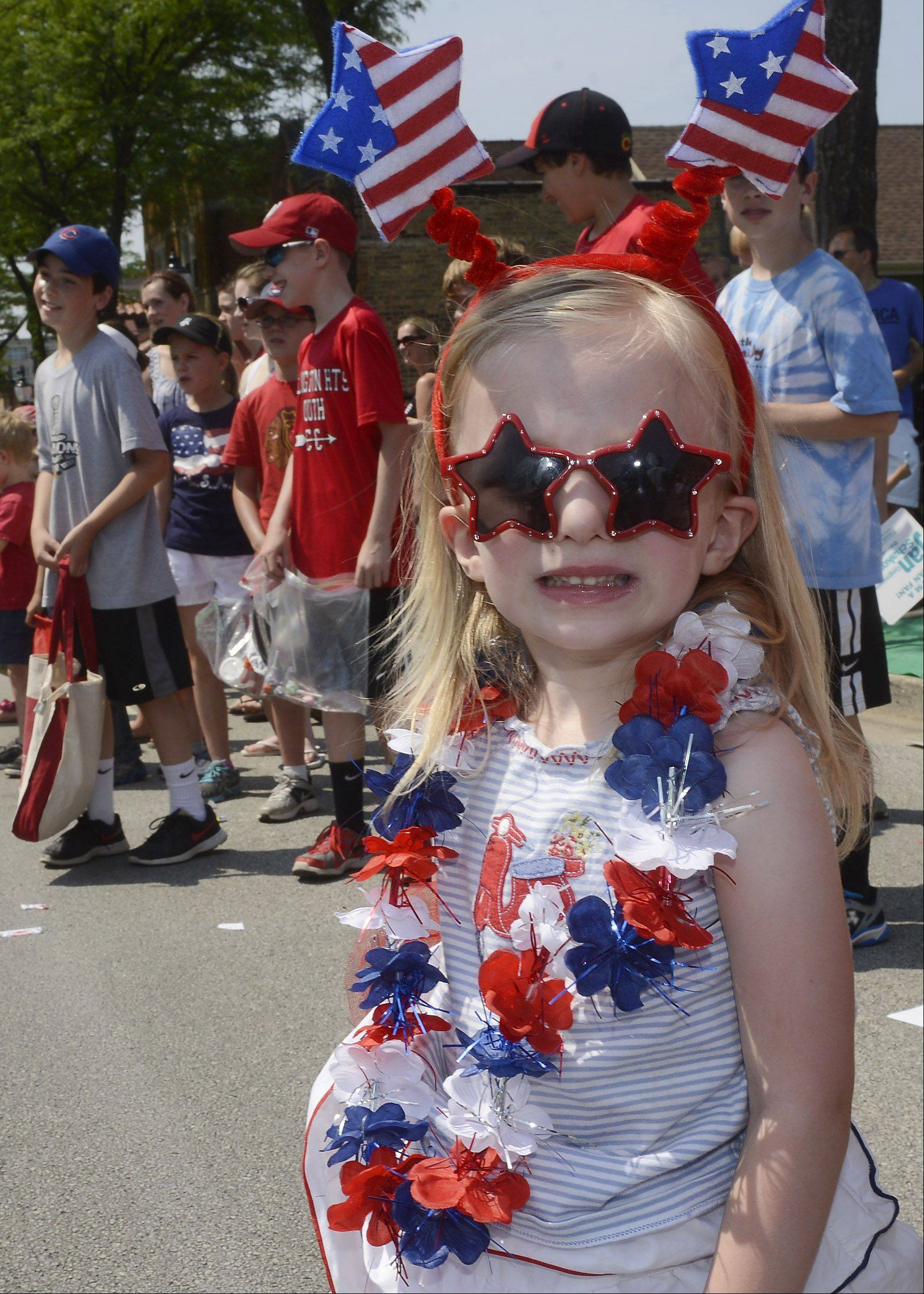 Emelia Weber, 4, of Arlington Heights waits for candy during the Arlington Heights Fourth of July parade Thursday.