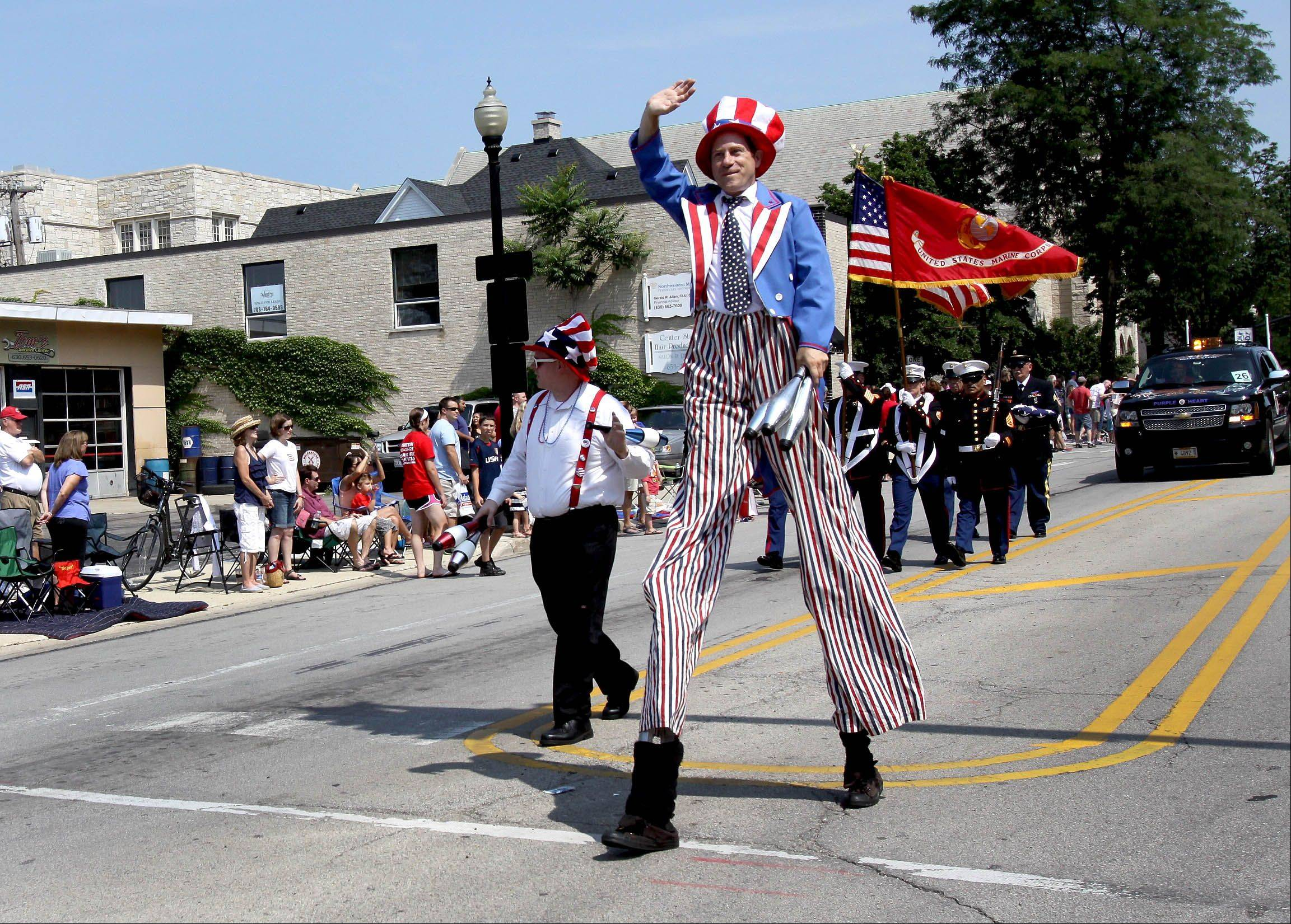 Uncle Sam makes his way down Main Street during the 4th of July parade in Wheaton on Thursday.
