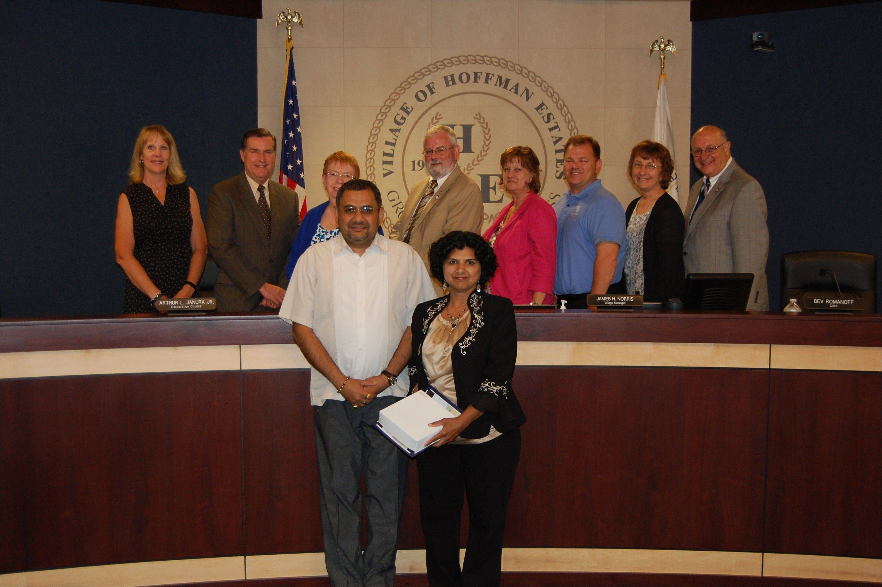 Niketa Dave, a 2013 recipient of the Barb Basl Award, with the Hoffman Estates village board.