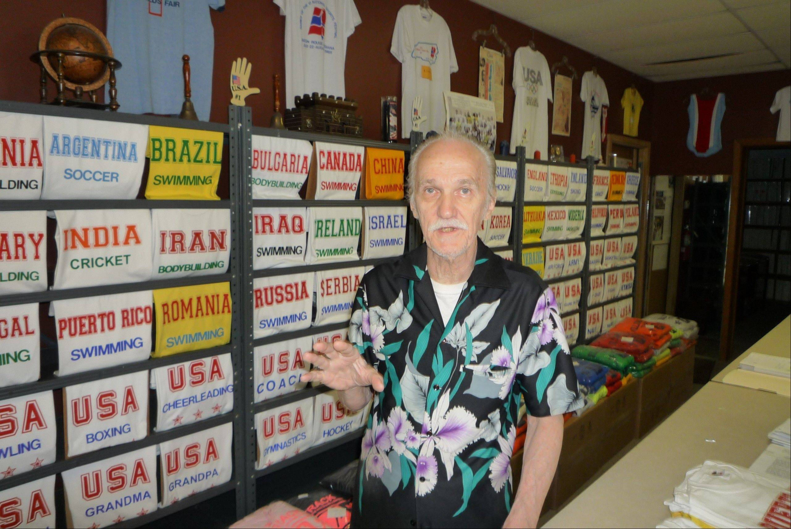 "Showing off just a portion of his vast T-shirt offerings, former presidential candidate Ed Gombos of Addison makes products promoting everything from ""Albania Body Building"" to a surprisingly best-selling ""Iran Track."""