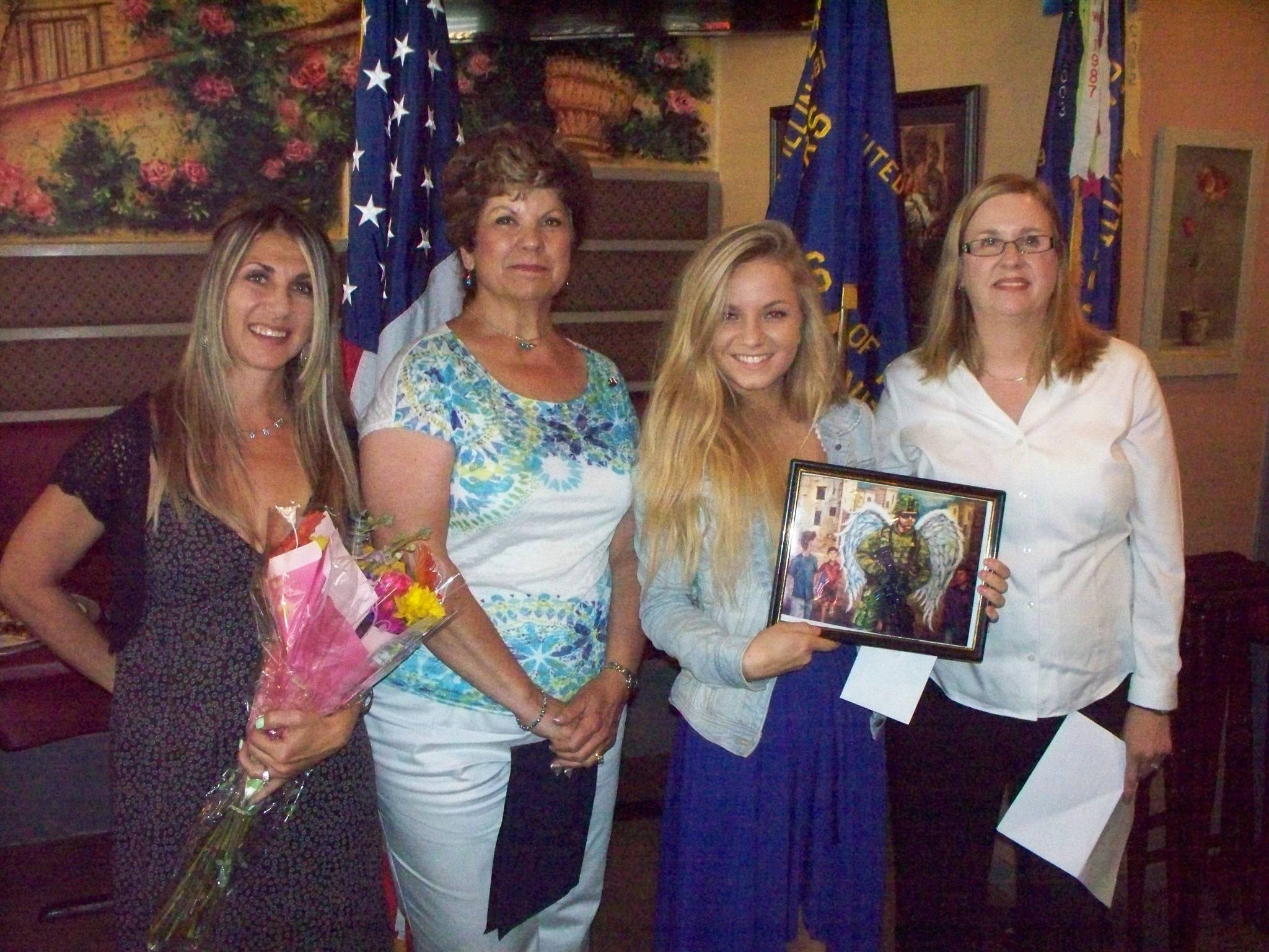 From left to right: Gina Freehill (Klaudia's mentor), Rochelle Prybylski (Friend who suggeted she enter the contest), Klaudia Sekura (winner), Charlene Wein ( Chairman, Patriotic Art Contest for 2202)