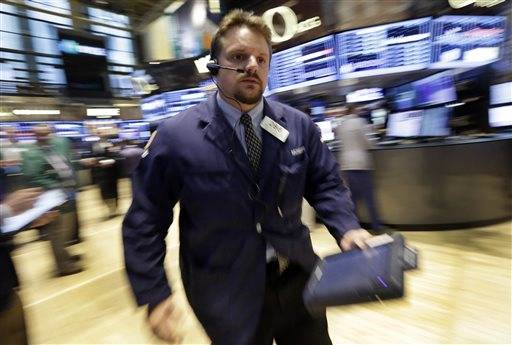 Stocks ended with a surge Friday after traders decided that a healthy job market mattered more than the Federal Reserve scaling back its economic stimulus.