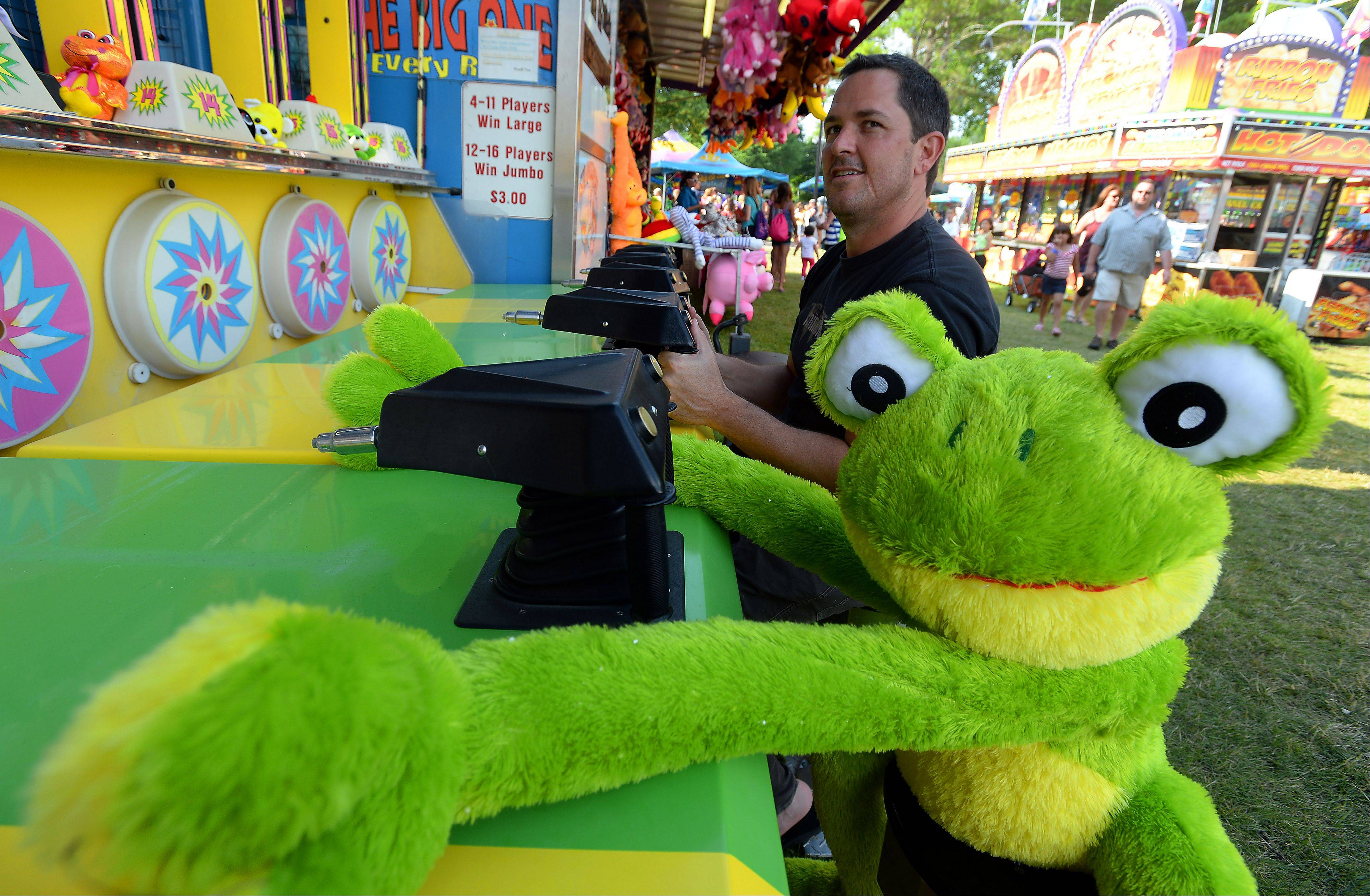 Steve Kirby of Arlington Heights had just won the frog at a basketball game at Frontier Days on Friday so he tried his luck at the water cannon game, with not as much success there.