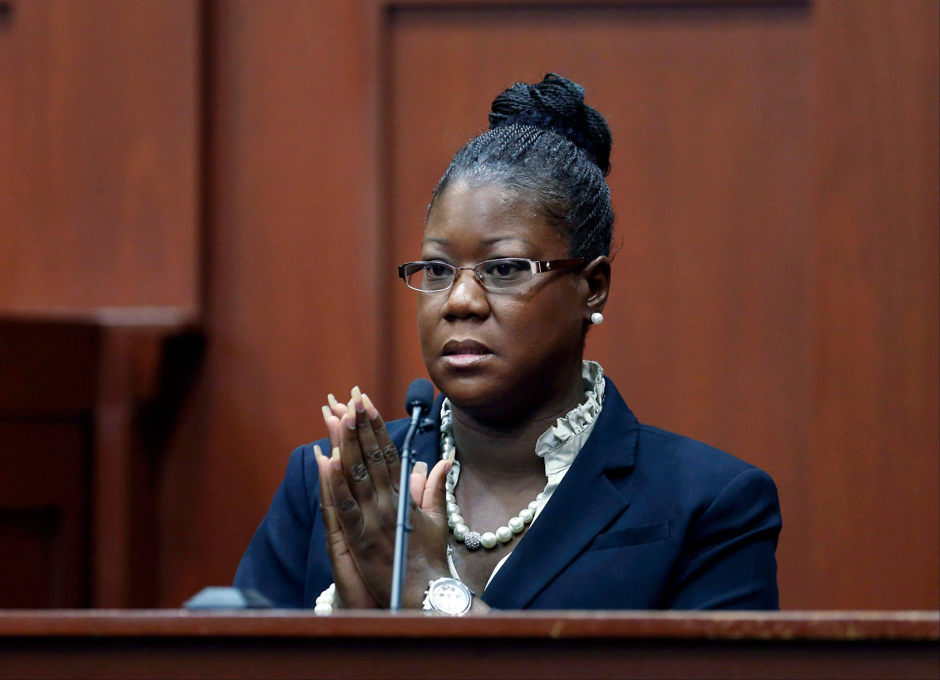 Trayvon Martin's mother, Sybrina Fulton, takes the stand during George Zimmerman's trial in Seminole County circuit court, Friday, July 5, 2013, in Sanford, Fla. Zimmerman has been charged with second-degree murder for the 2012 shooting death of Trayvon Martin. (AP Photo/Orlando Sentinel, Gary W. Green, Pool)
