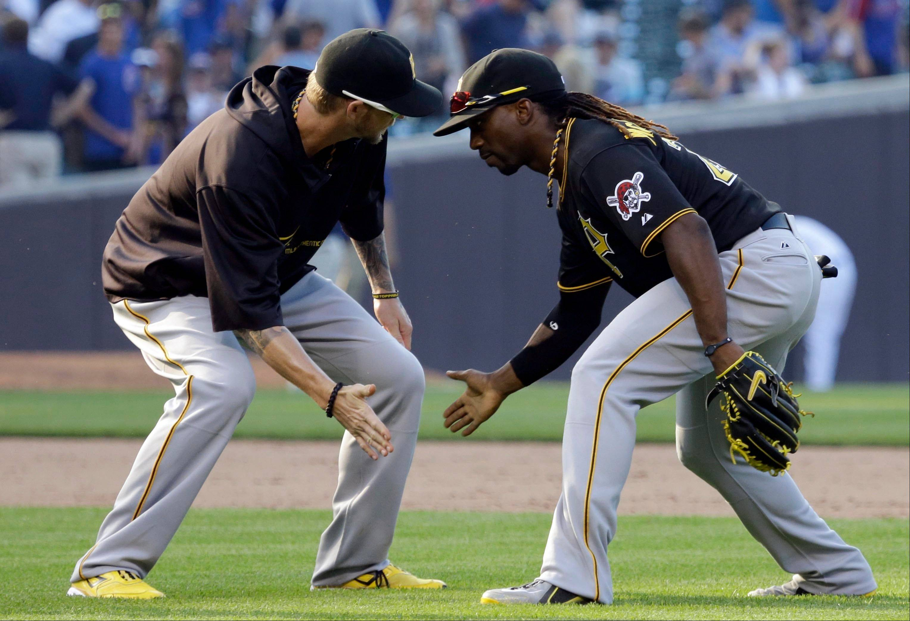 Pittsburgh�s Andrew McCutchen, right, celebrates with A.J. Burnett after they defeated the Cubs 6-2 on Friday at Wrigley Field.