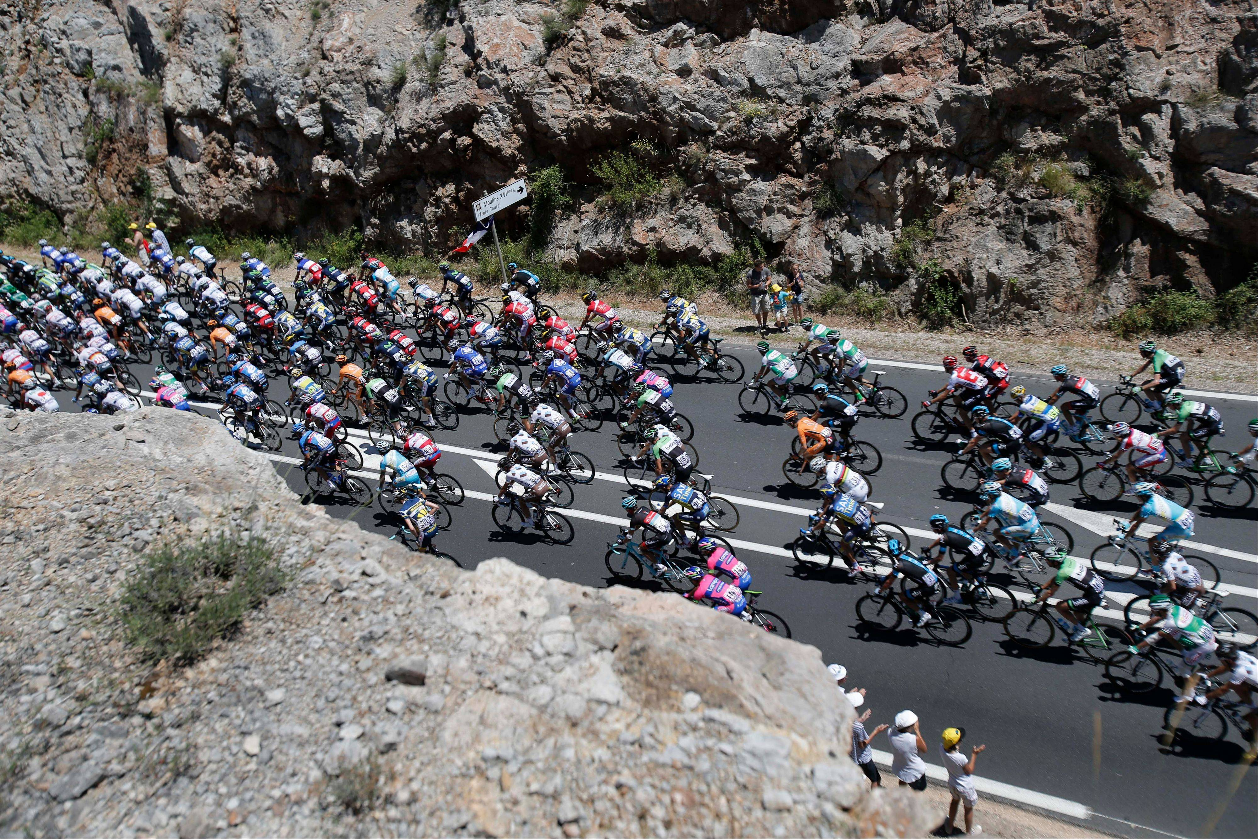 The pack passes during the seventh stage of the Tour de France cycling race over 205.5 kilometers (128.5 miles) with start in Montpellier and finish in Albi, southern France, Friday July 5, 2013. (AP Photo/Christophe Ena)