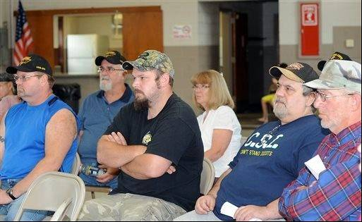 Miners listen as other workers voice their concerns to representatives from Sen. Joe Manchin's office and Secretary of State Natalie Tennant office during a town hall style meeting in Monongah, W.Va.