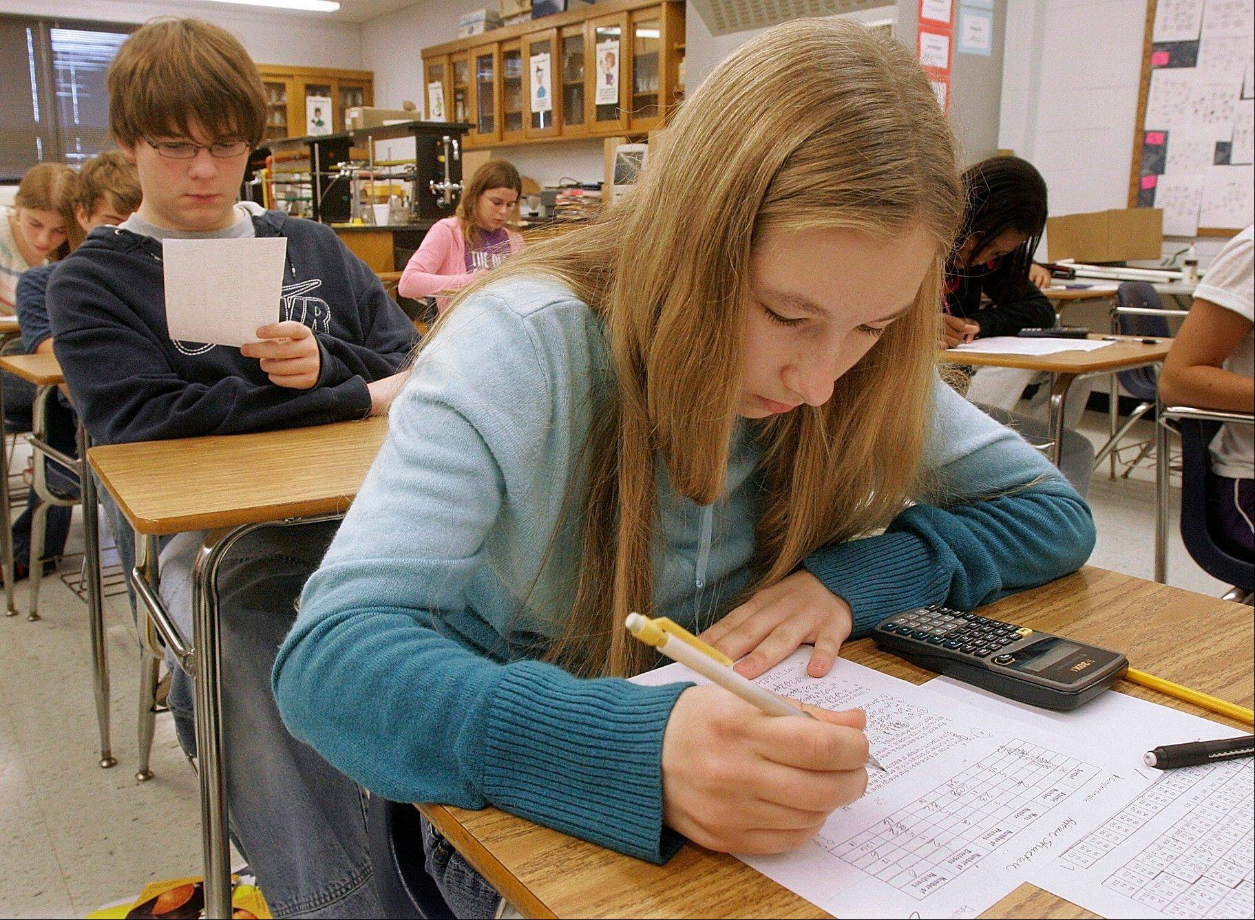 Tenth grade students take a chemistry test while in class at Springfield High School in Springfield. Illinois high school juniors will be tested on writing skills for the first time in years next spring during state standardized tests.
