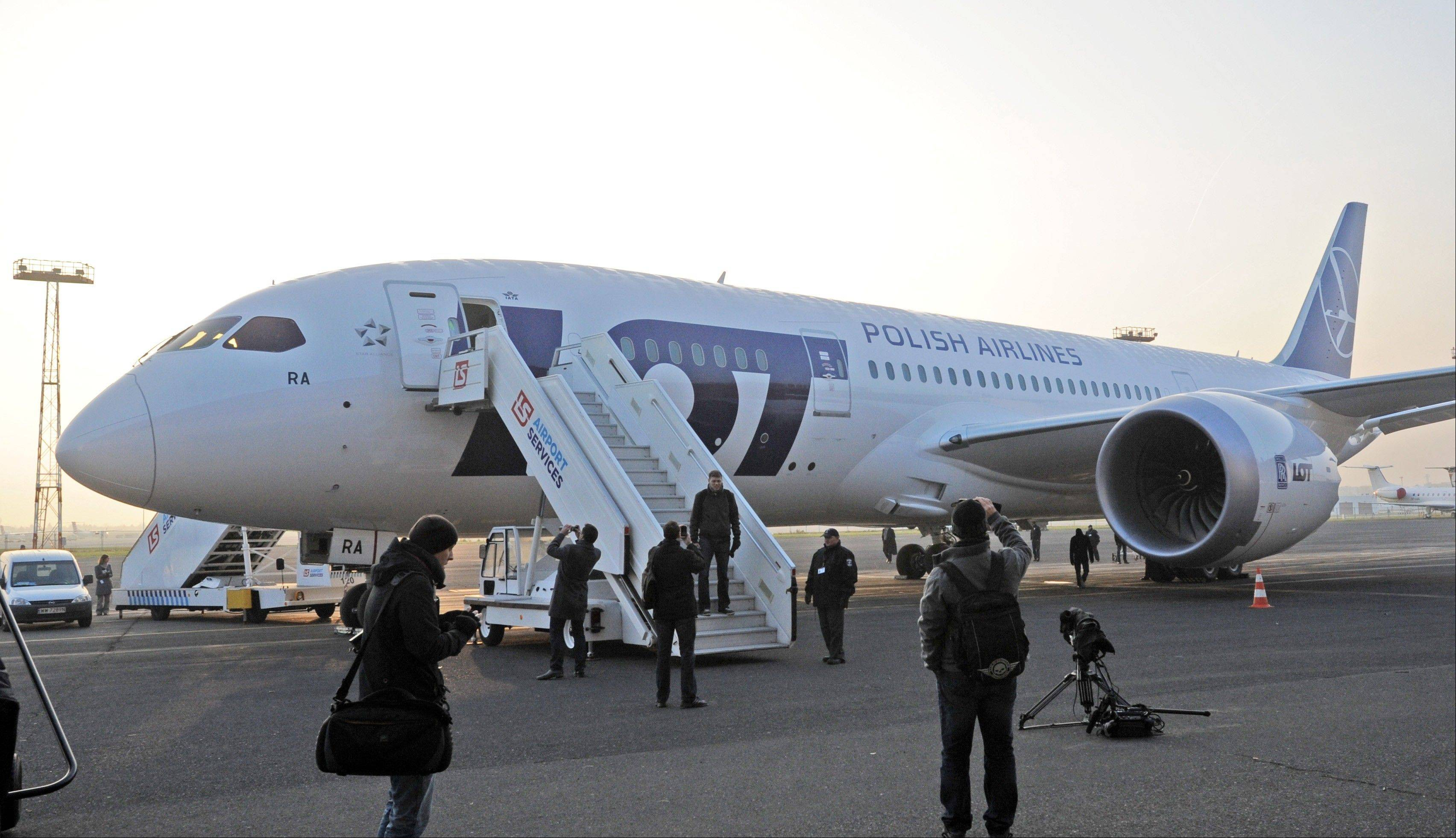 This Nov. 15, 2012 file photo shows Polish Airlines LOT's first Boeing 787 Dreamliner at the Chopin airport tarmac in Warsaw, Poland.