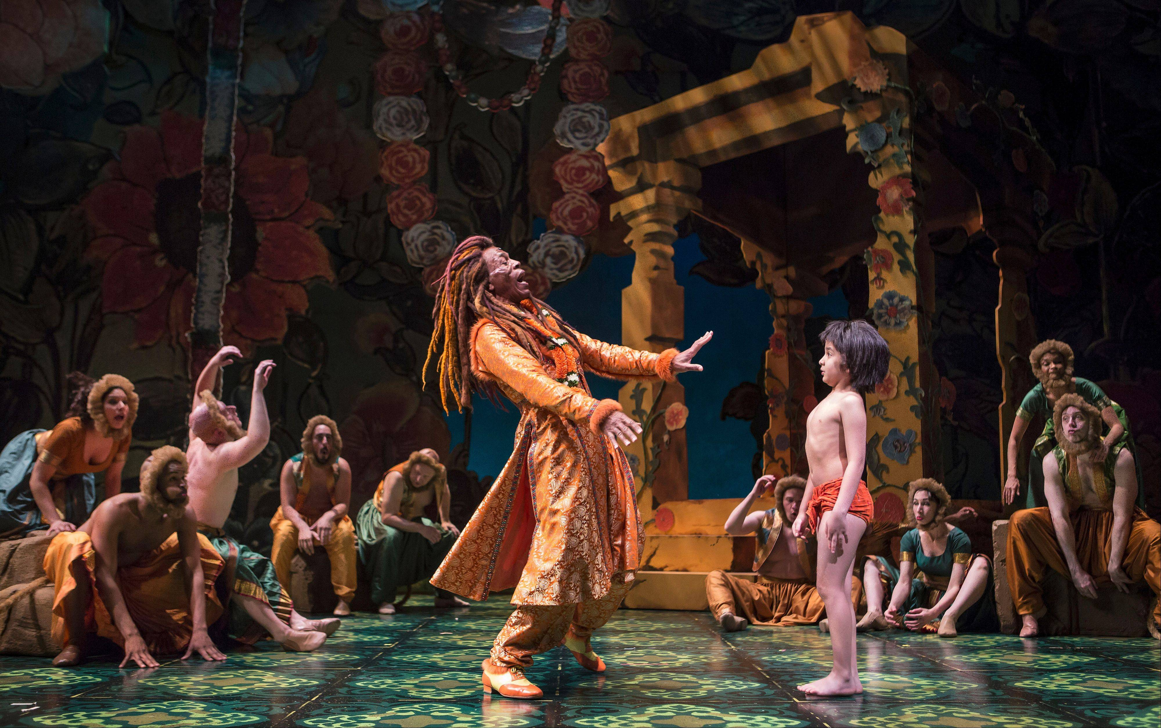 "Andre De Shields' King Louis, left center, entertains young Mowgli (Akash Chopra) and brings down the house with his raucous rendition of ""I Wanna Be Like You"" in Goodman Theatre's spectacular production of ""The Jungle Book,"" directed and adapted by Tony Award-winner Mary Zimmerman."