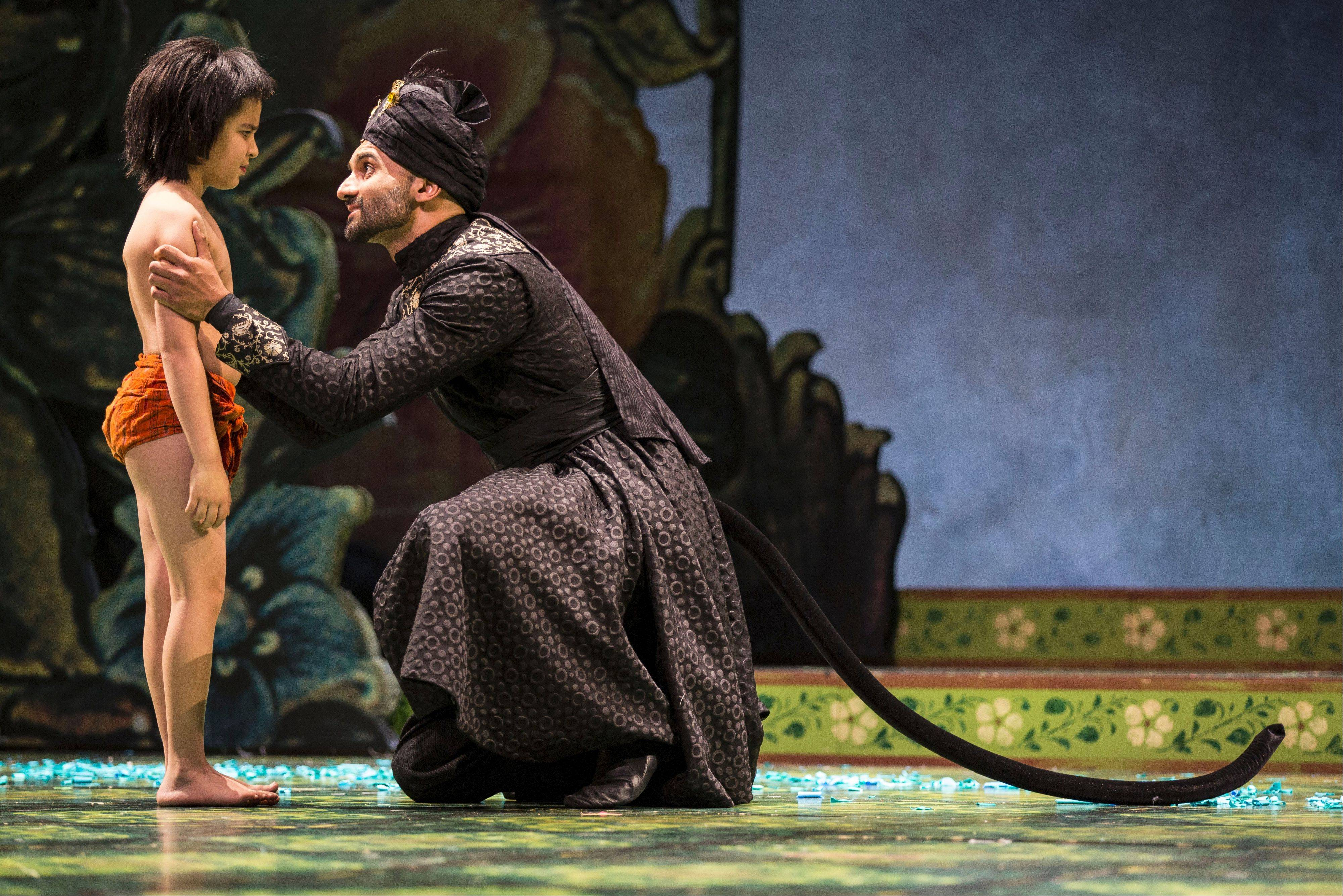 "The panther Bagheera (Usman Ally), right, counsels the man-cub Mowgli (Akash Chopra) in Goodman Theatre's world-premiere stage adaptation of ""The Jungle Book,"" which is co-produced by Boston's Huntington Theatre Company."