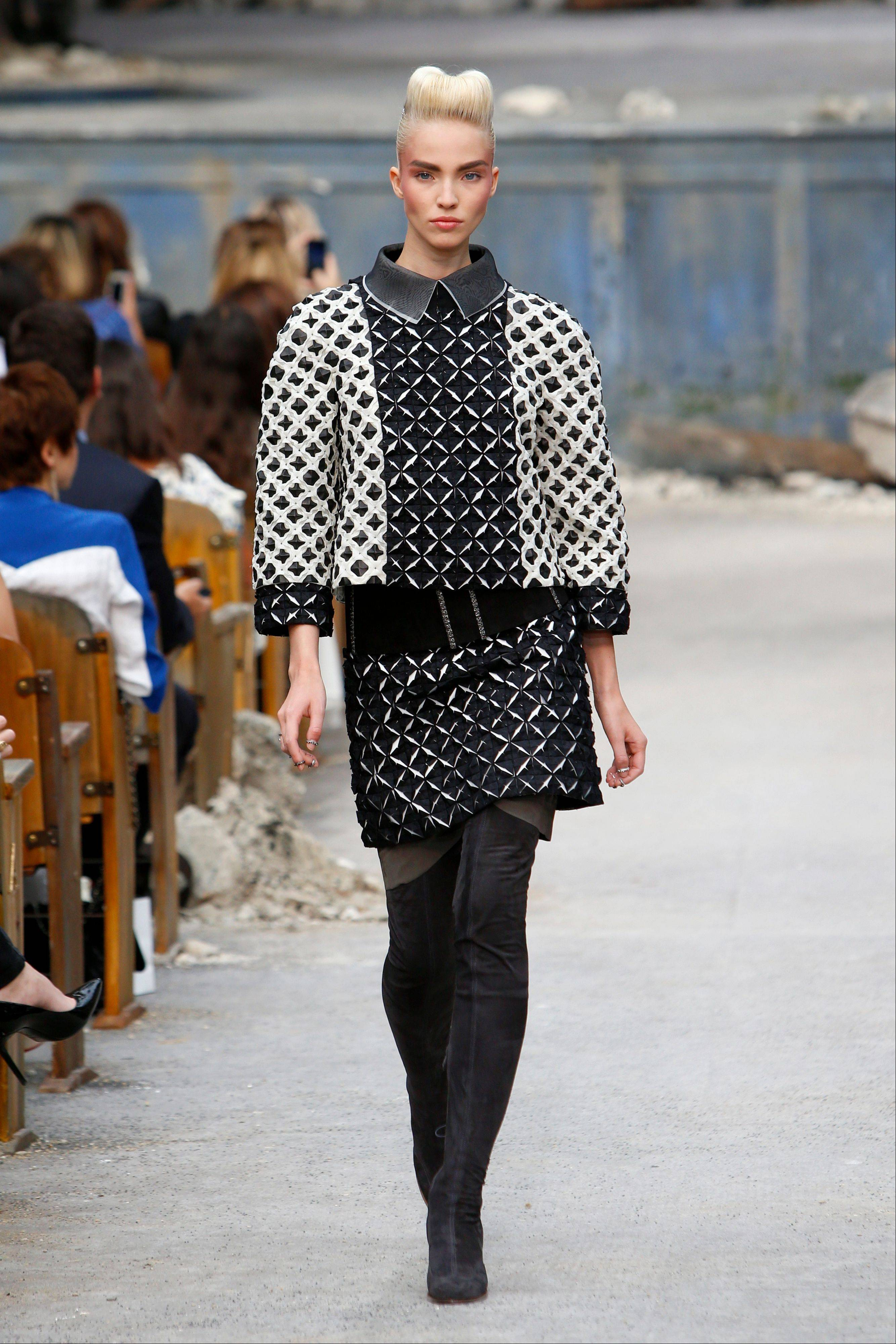 A model wears a creation by German fashion designer Karl Lagerfeld for Chanel's Haute Couture Fall-Winter 2013-2014 collection, presented Tuesday, July 2, 2013 in Paris.