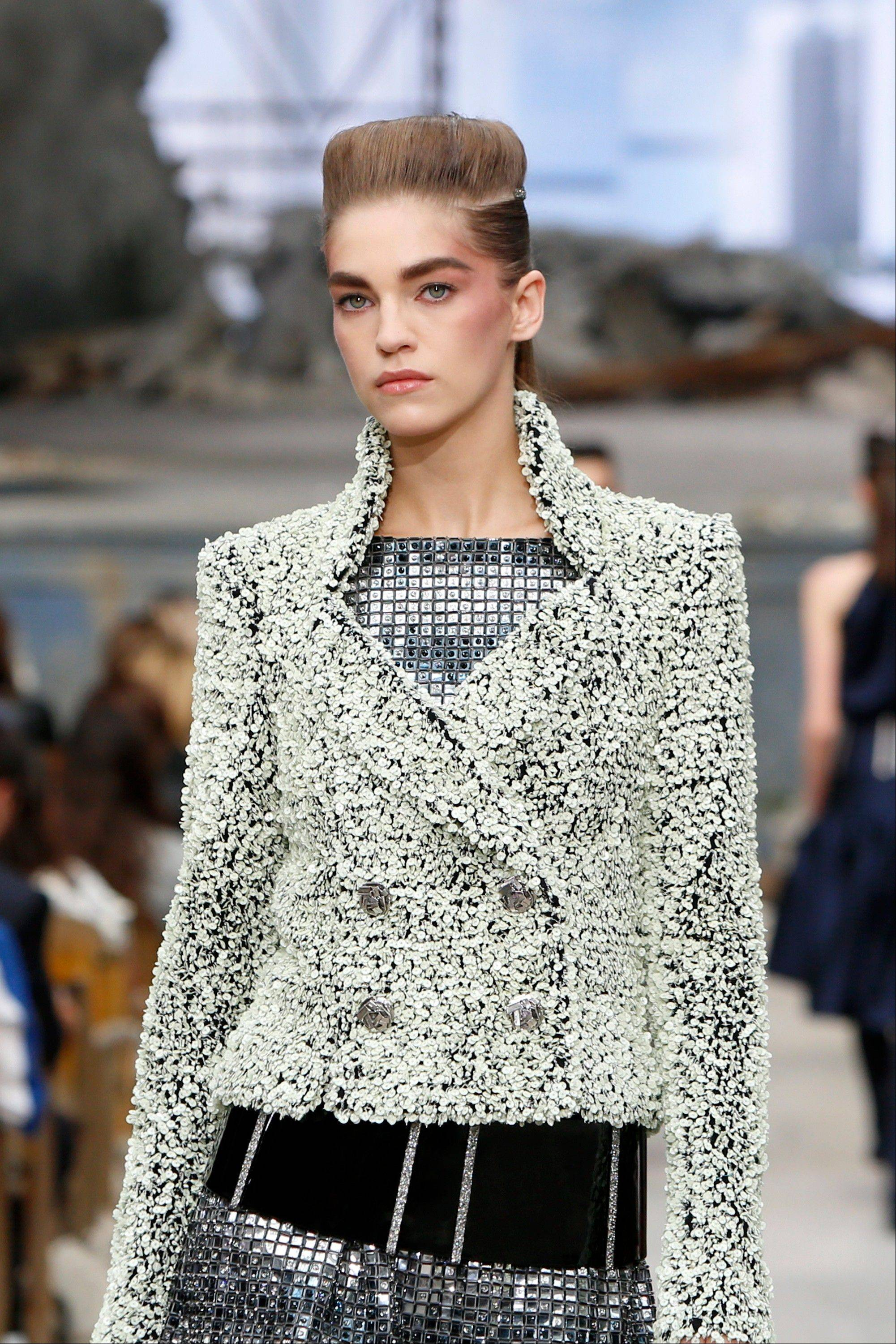 A model wears a creation by German fashion designer Karl Lagerfeld for Chanel's Haute Couture Fall-Winter 2013-2014 collection.