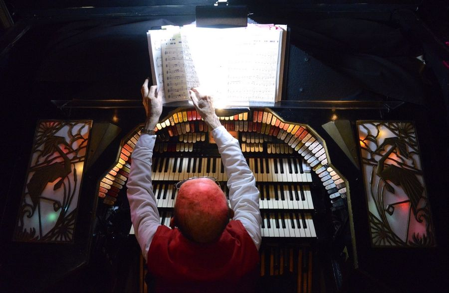 Jim Shaffer gets his sheet music in order while the organ sits below stage in its storage compartment before a recent performance. When Shaffer starts to play, he hits a button and the organ rises to stage level. For some events, he plays an hour, while for rock shows he'll usually play for about 10 minutes prior to the opening act.