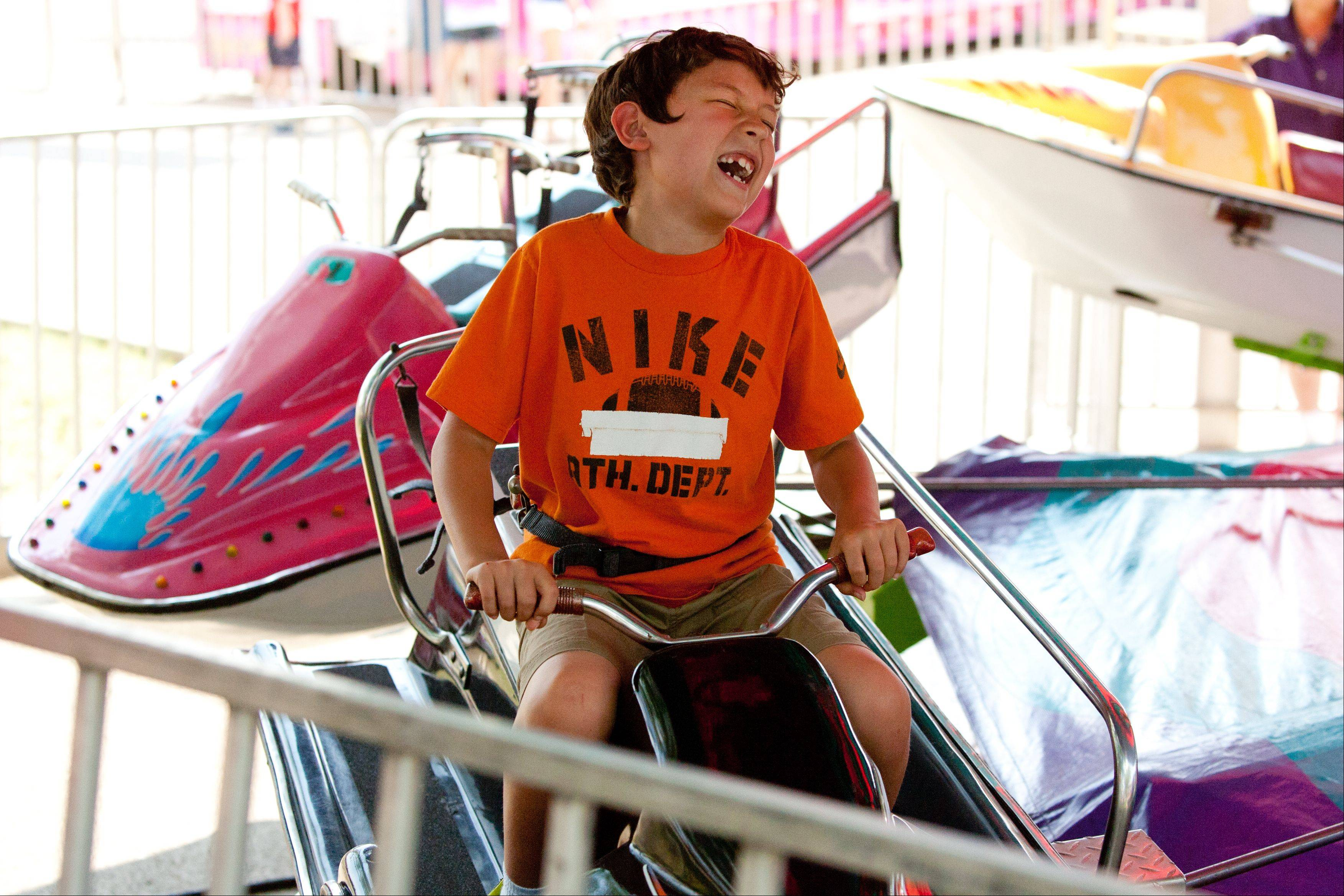 Devyn Sturgills, 9, of Plainfield sails along the rails, during the Eyes to the Skies Festival at Community Park in Lisle.