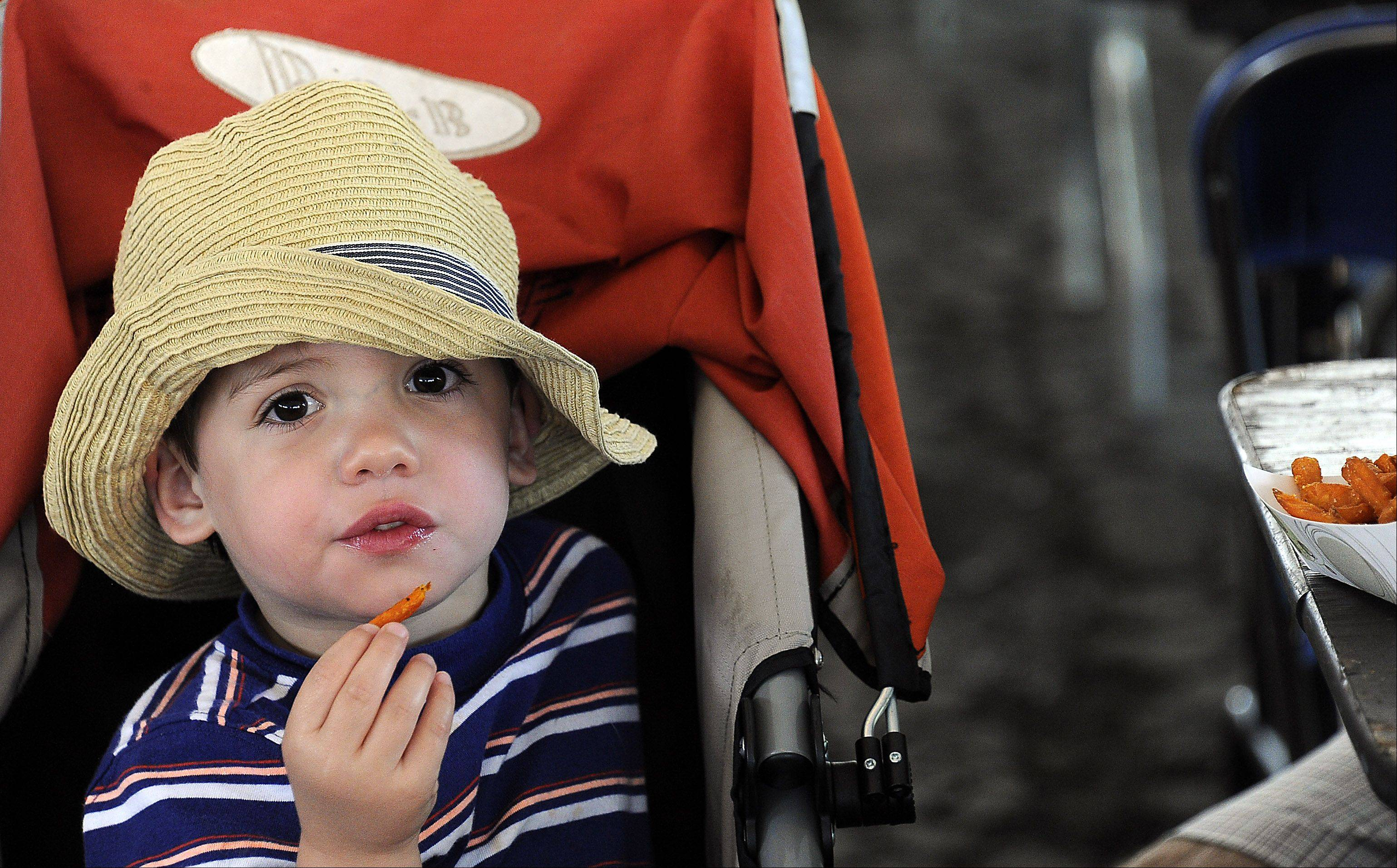 Jackson Penz,3, of Arlington Heights chows down on French Fries at Frontier Days.