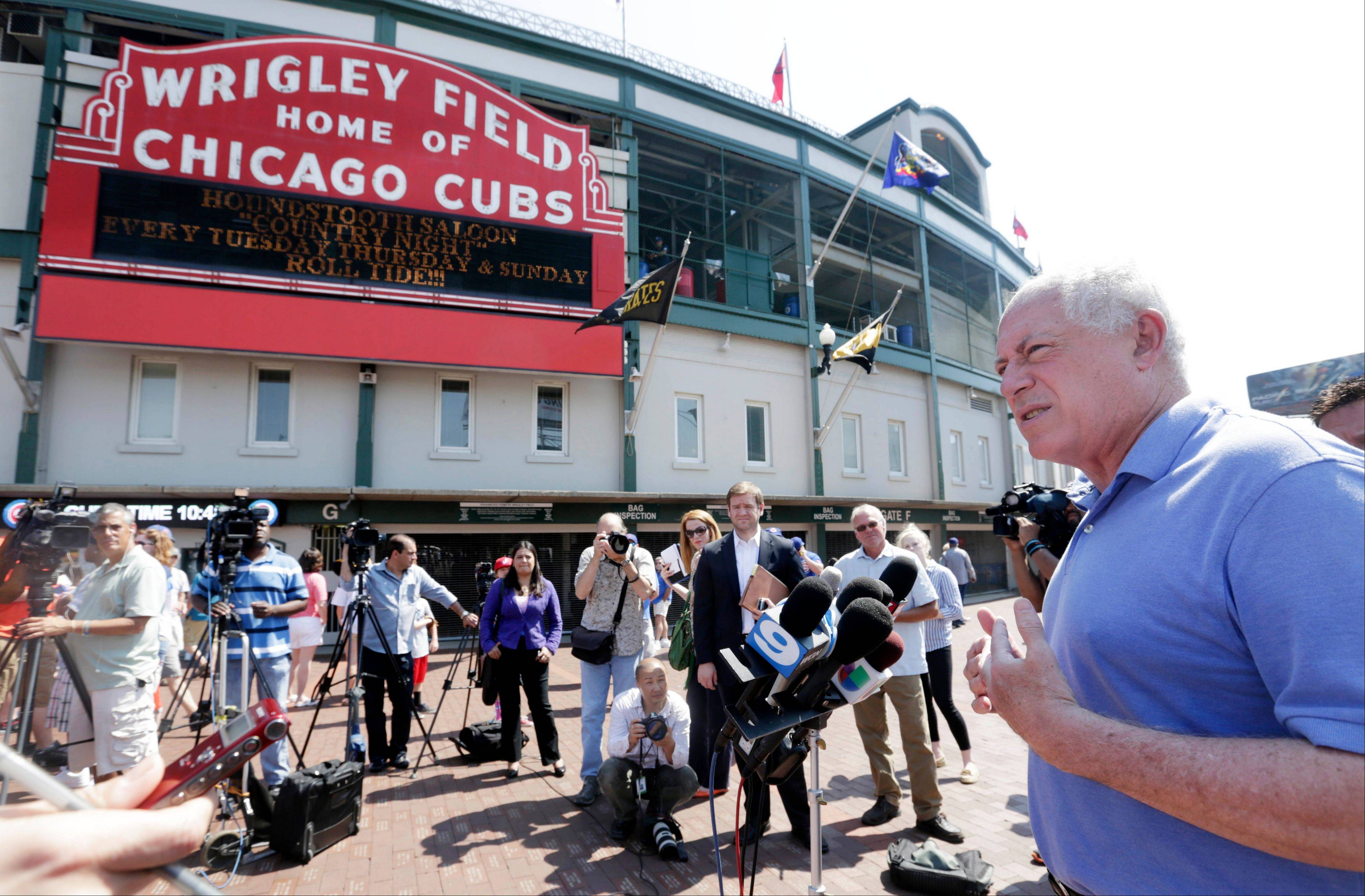 "Gov. Pat Quinn speaks to the media outside Wrigley Field, standing with the many bars and restaurants of Chicago's Wrigleyville neighborhood as a backdrop, on Friday in Chicago. Quinn visited one of Illinois' most popular entertainment districts to press his message that guns and alcohol are a ""toxic mix."""