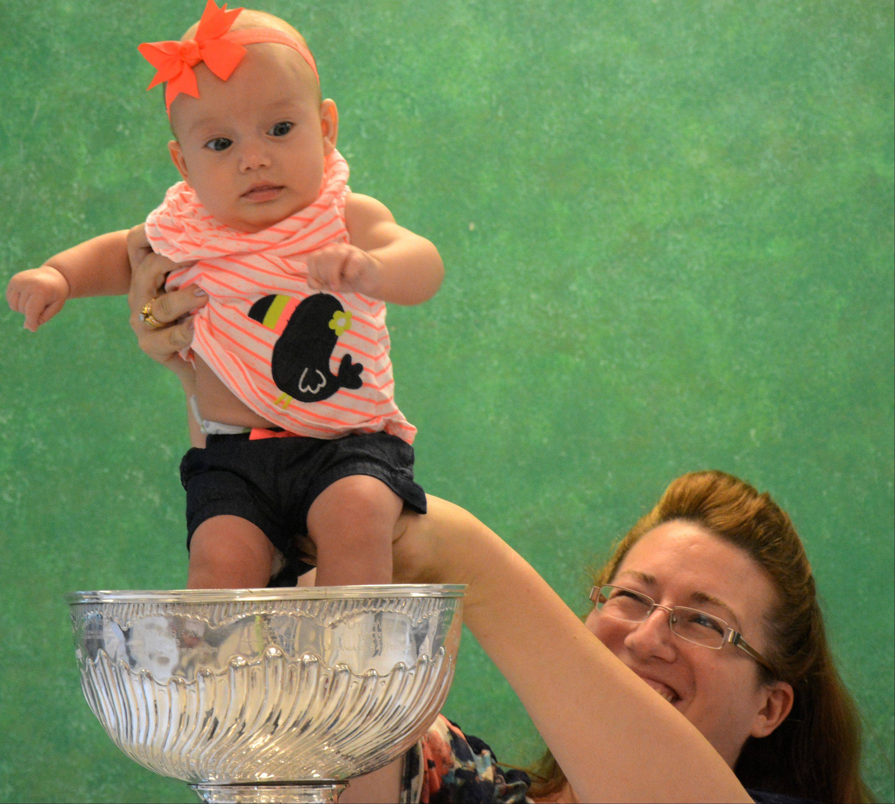 Dave Dvorak/ddvorak@dailyherald.comCandace Lewnard, of Mount Prospect, holds daughter Sofia, 4 months, in the Stanley Cup at the Daily Herald office Friday in Arlington Heights.