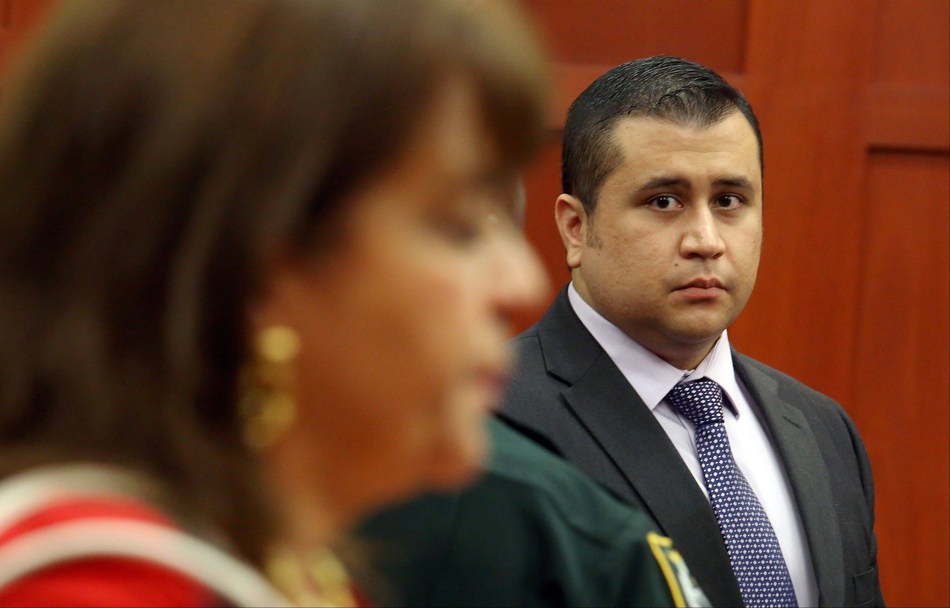 George Zimmerman looks at State Attorney Angela Corey, during a recess in his trial at the Seminole circuit court, in Sanford, Fla., Wednesday, July 3, 2013. Zimmerman is charged with second-degree murder in the fatal shooting of Trayvon Martin, an unarmed teen, in 2012.
