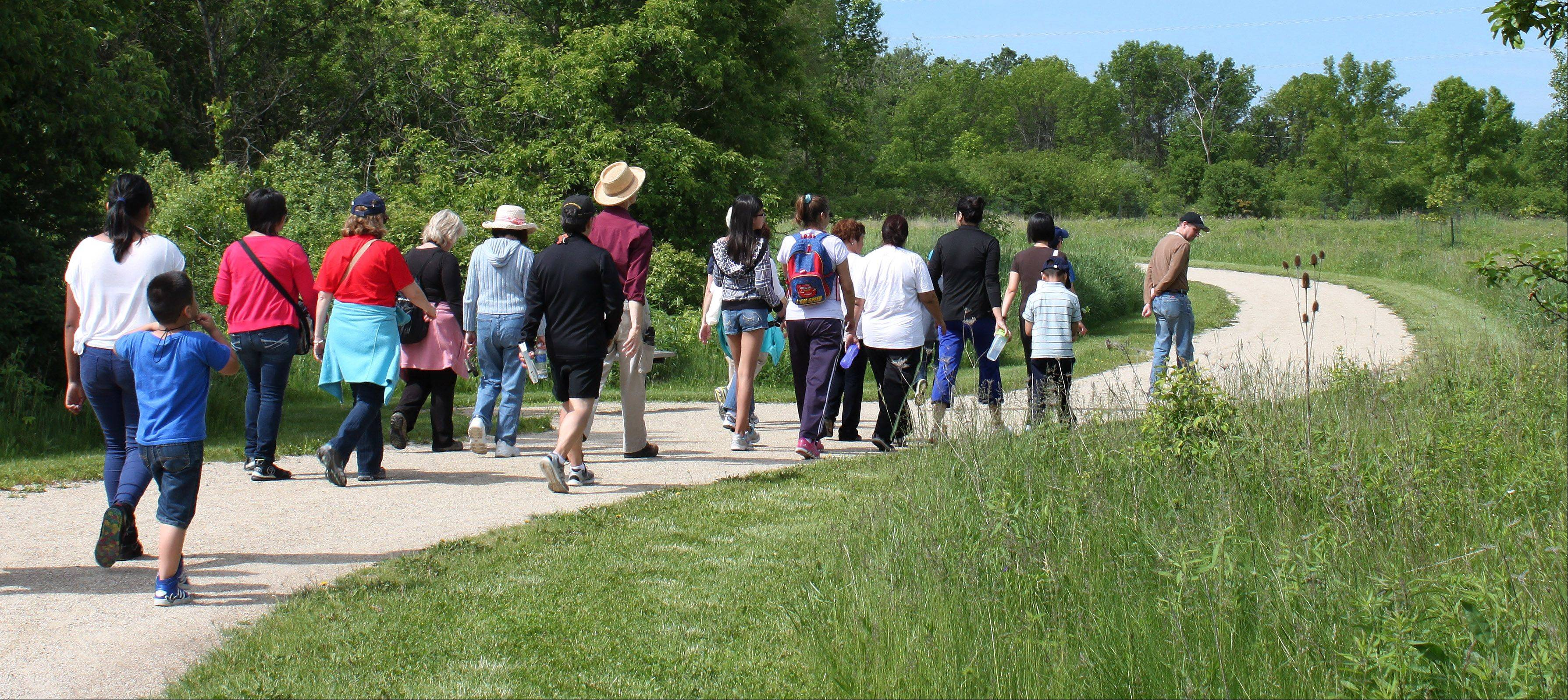 One recent bilingual guided nature hike toured Sun Lake Forest Preserve near Lake Villa. The hikes are sponsored by Friends of Ryerson Woods and Lake County Forest Preserve District with help from several community partners.