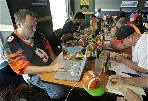 Fantasy football team owners conduct their draft. More than 35 million adults in the United States and Canada participate in fantasy leagues, according to the Fantasy Sports Trade Association.