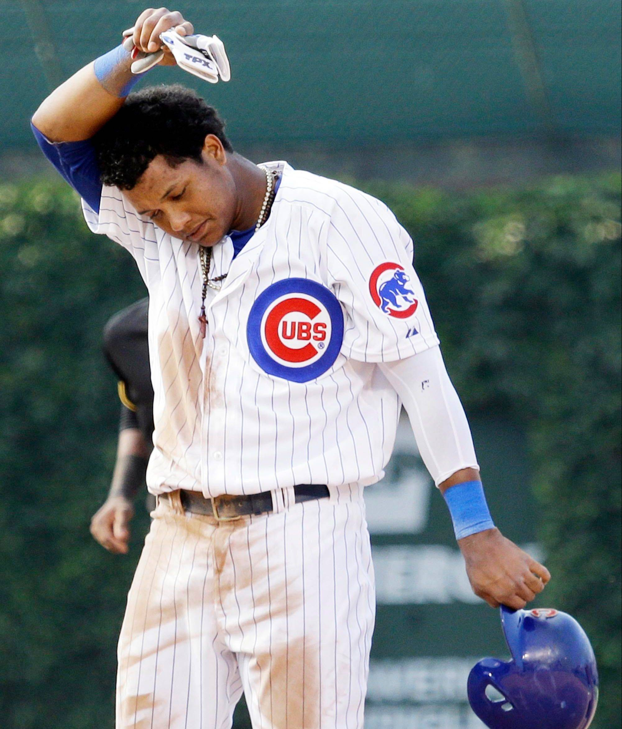 "Starlin Castro wipes his face after he was picked off second base to end the eighth inning of the Cubs' loss Friday. ""I feel really, really bad, because that can't happen,"" Castro said."