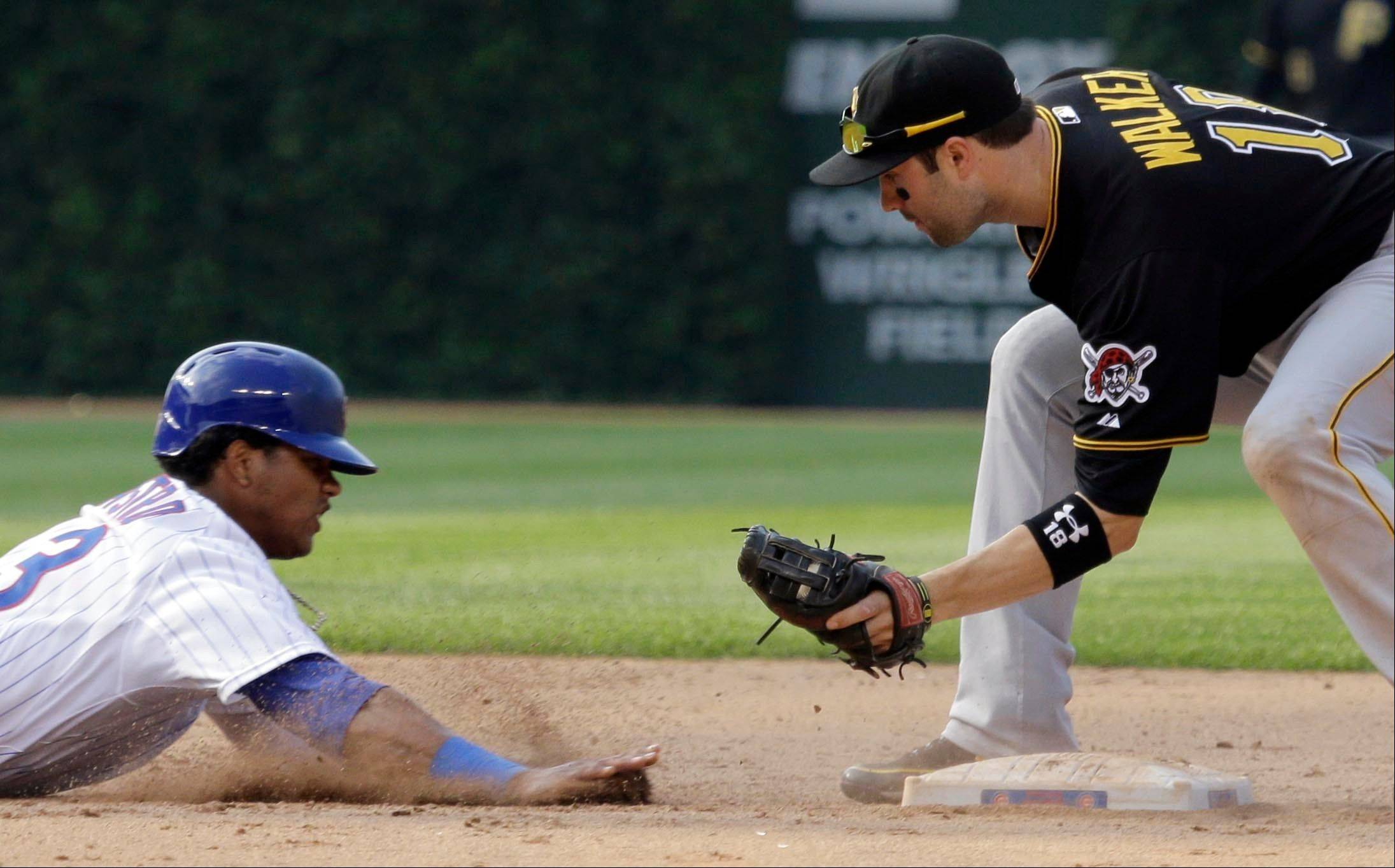 Pittsburgh Pirates second baseman Neil Walker tags out Chicago Cubs' Starlin Castro during the eighth inning Friday.