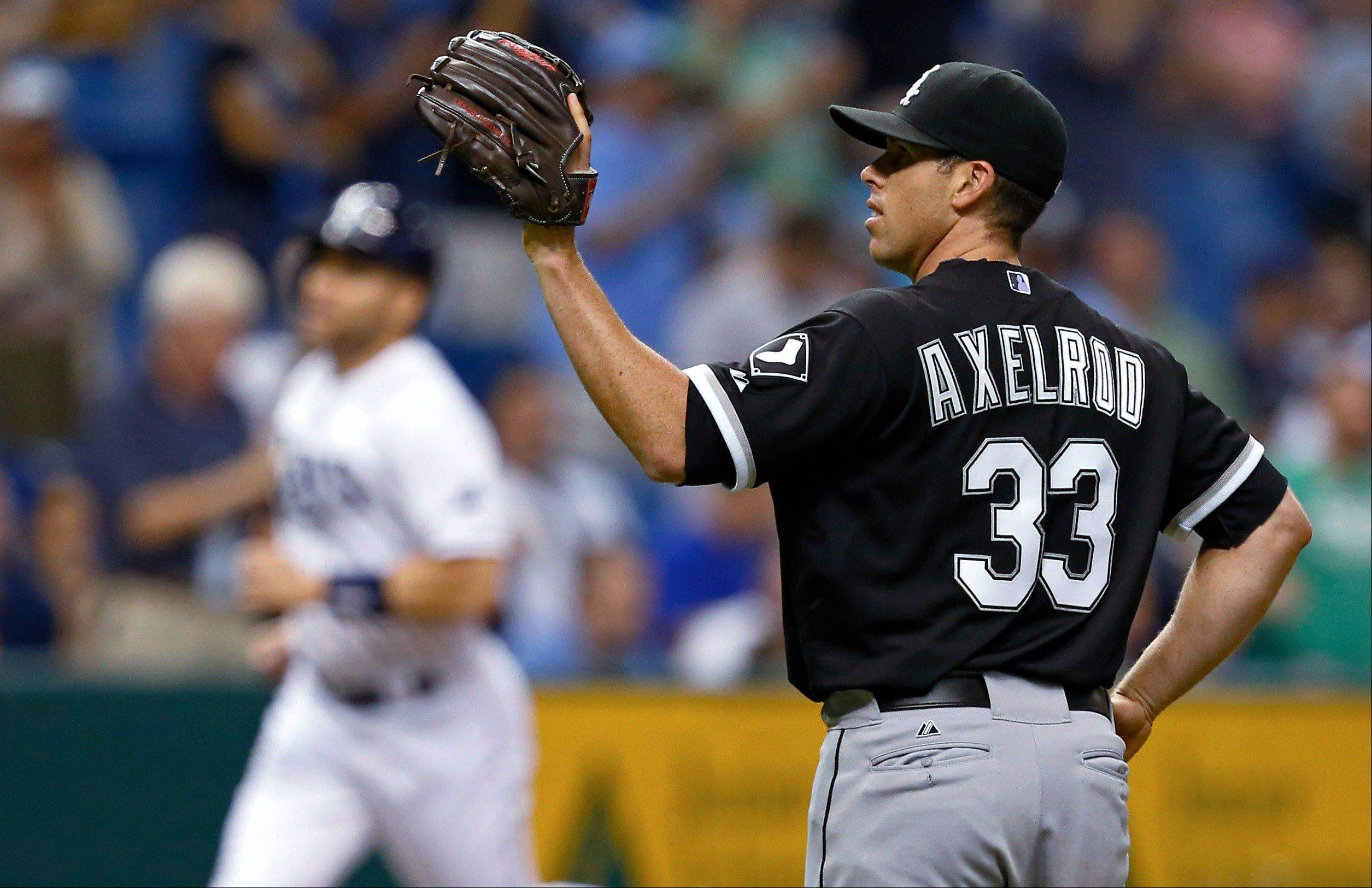 White Sox starting pitcher Dylan Axelrod waits for a new ball after giving up a two-run home run to the Rays' Jose Molina during the second inning Friday in St. Petersburg, Fla.