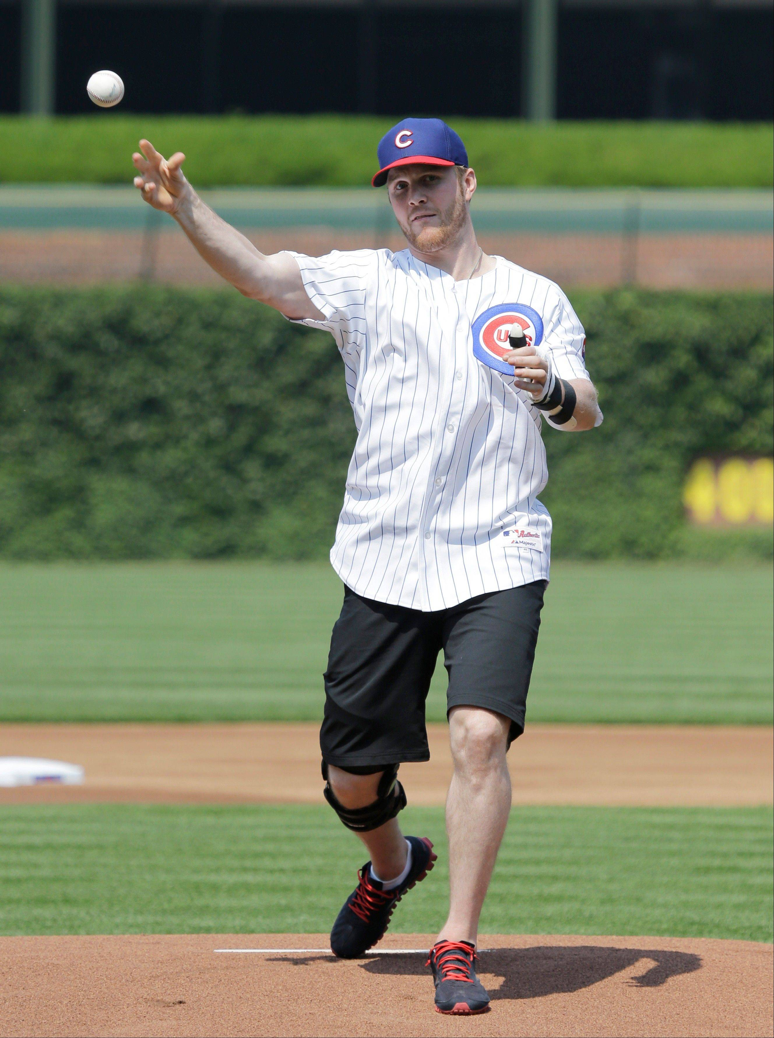 The Blackhawks' Bryan Bickell throws a ceremonial first pitch before Friday's game between the Pirates and Cubs at Wrigley Field.