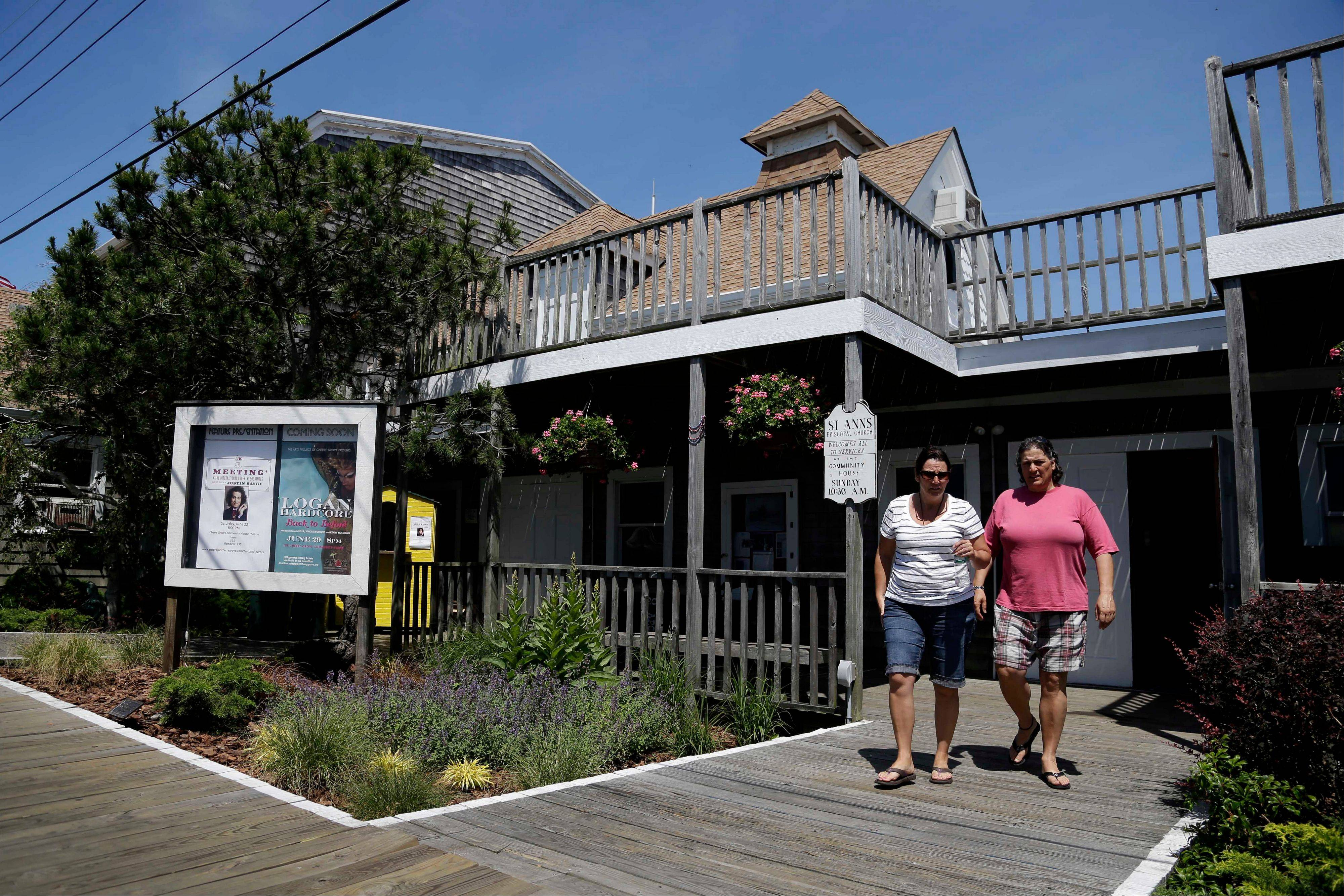 People leave a Sunday morning church service at the Cherry Grove Community House and Theater on Fire Island in Cherry Grove, N.Y. Residents of Cherry Grove are celebrating the addition of the theater to the National Register of Historic Places.