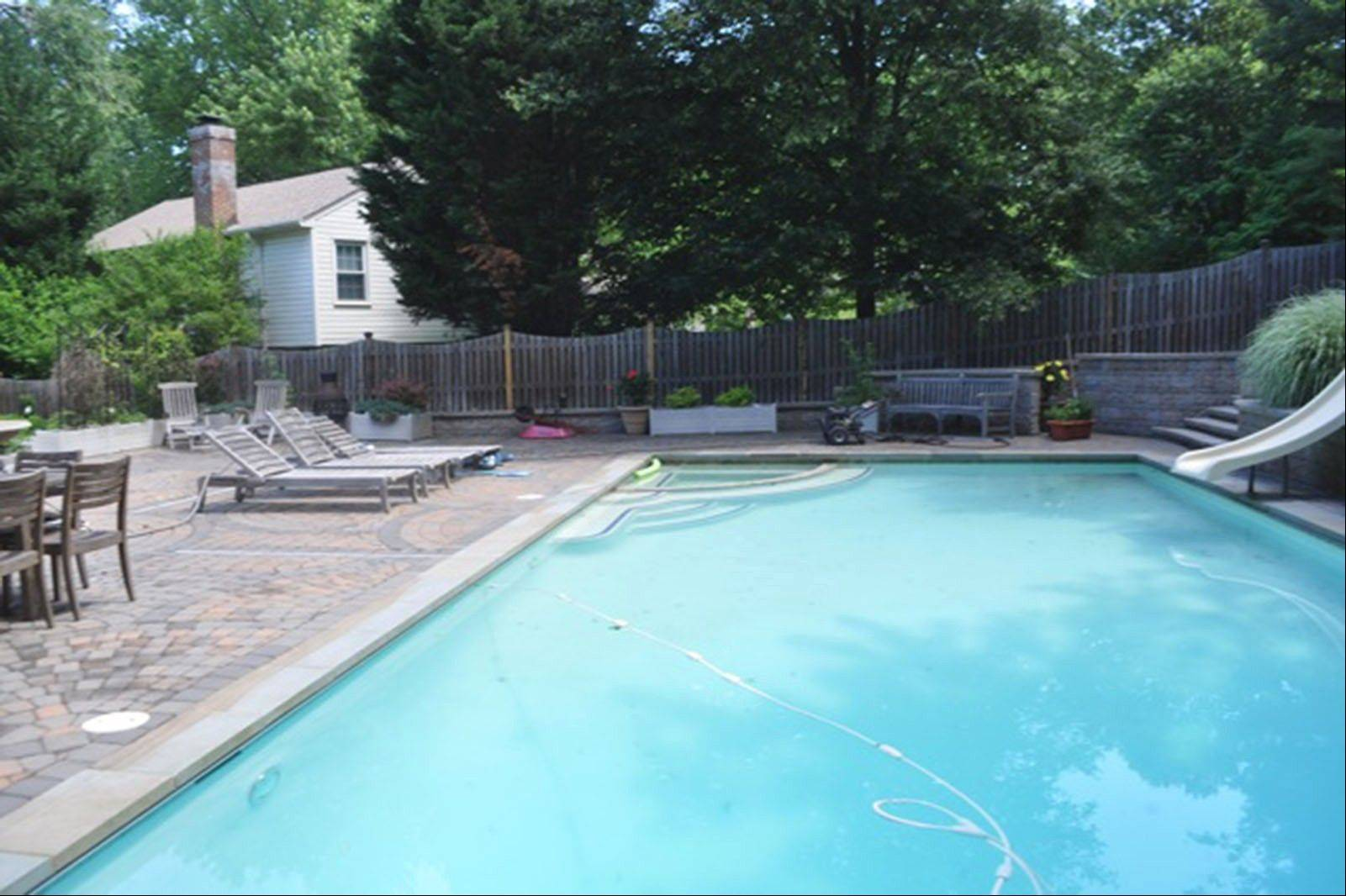Buyers tend to pay more attention to outdoor features in the summer, like the Elmas' swimming pool.