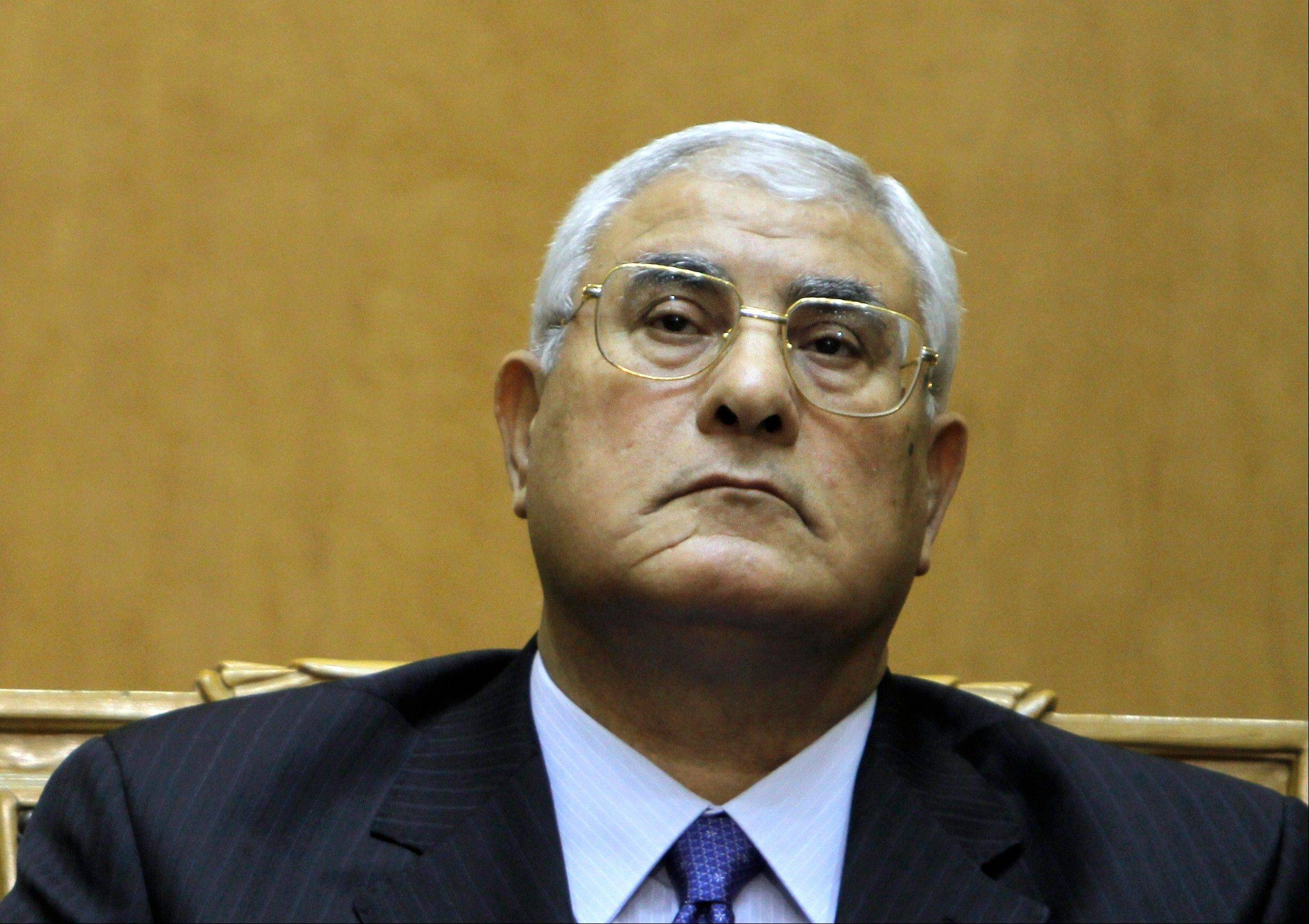 In this file photo taken Thursday, July 4, 2013, Egypt's chief justice Adly Mansour listens to a speech during his swearing in as interim president. Interim president Mansour held talks Saturday, July 6, 2013, with the army chief and interior minister after an outburst of violence between supporters and opponents of ousted leader Mohammed Morsi that killed at least 36 people across the country and deepened the battle lines in the divided nation.